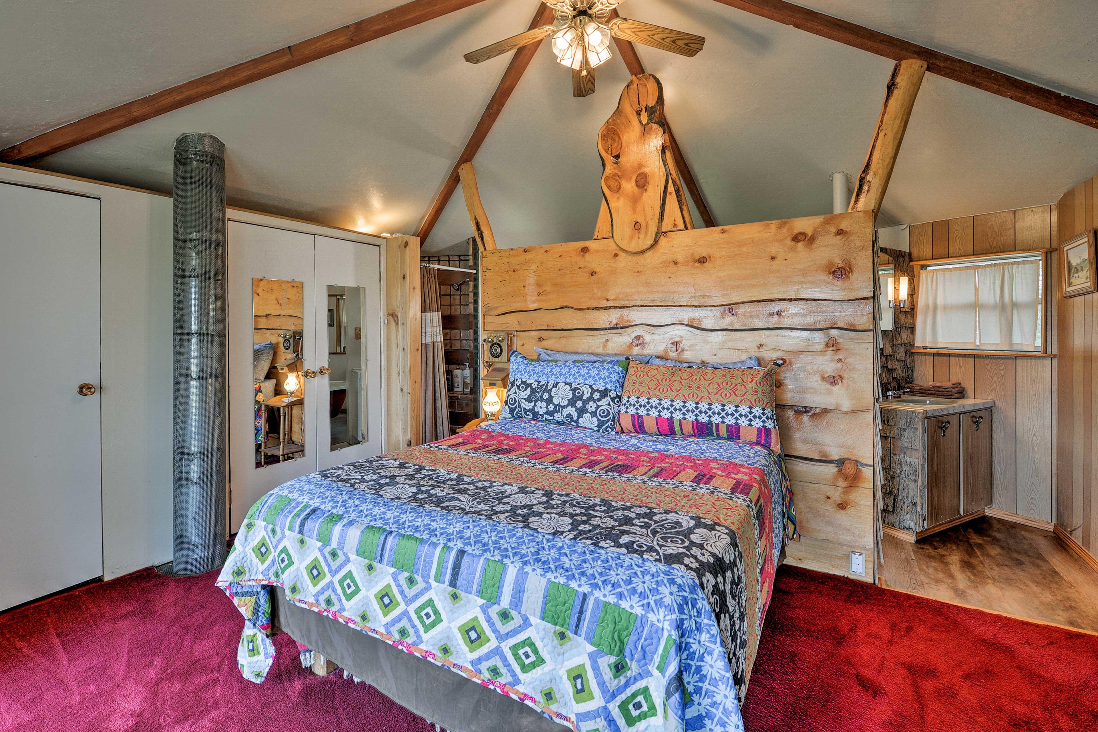 Doze off to sleep in the bedroom's queen bed.