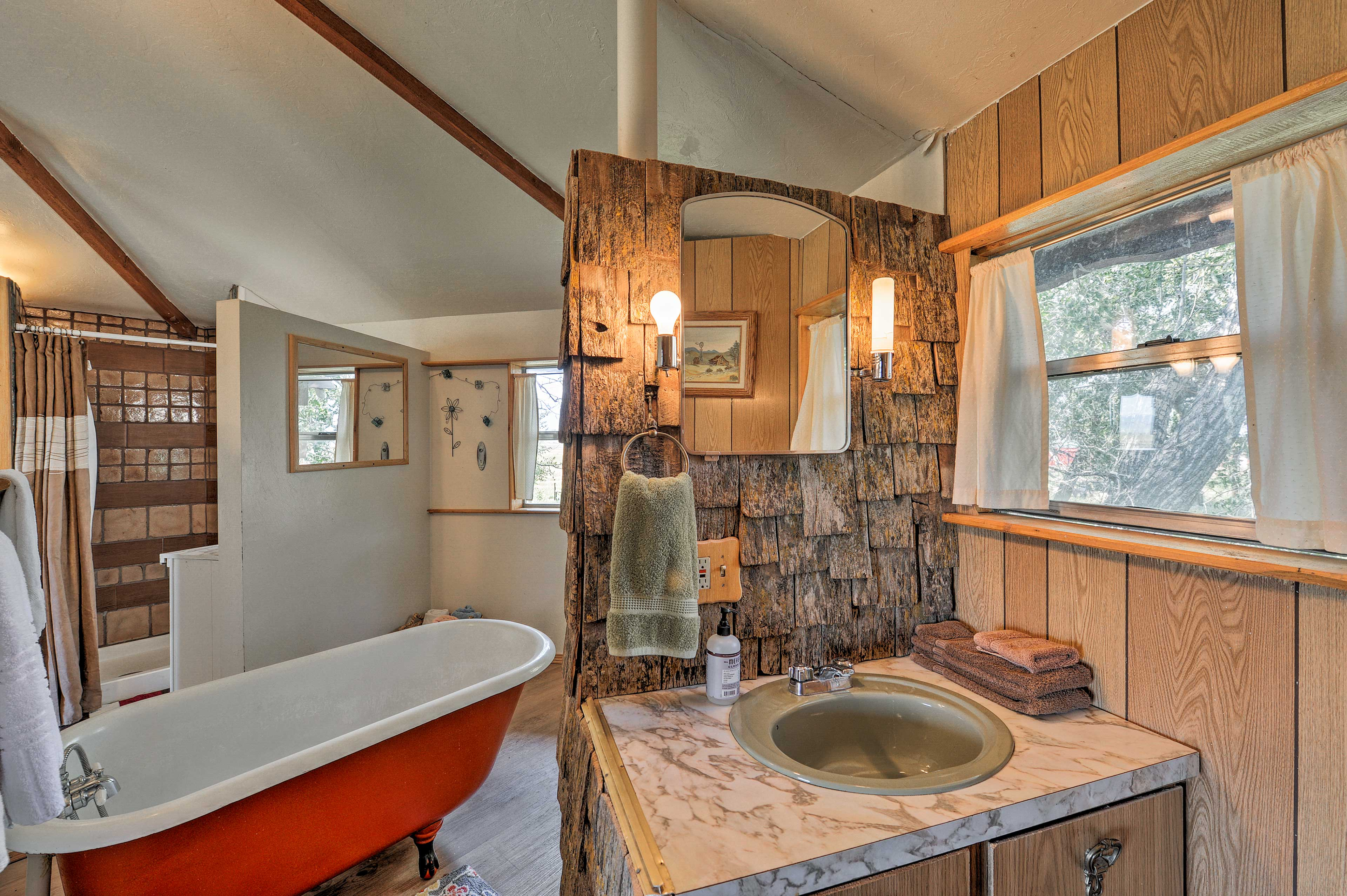 Prepare for the day in the rustic bathroom.