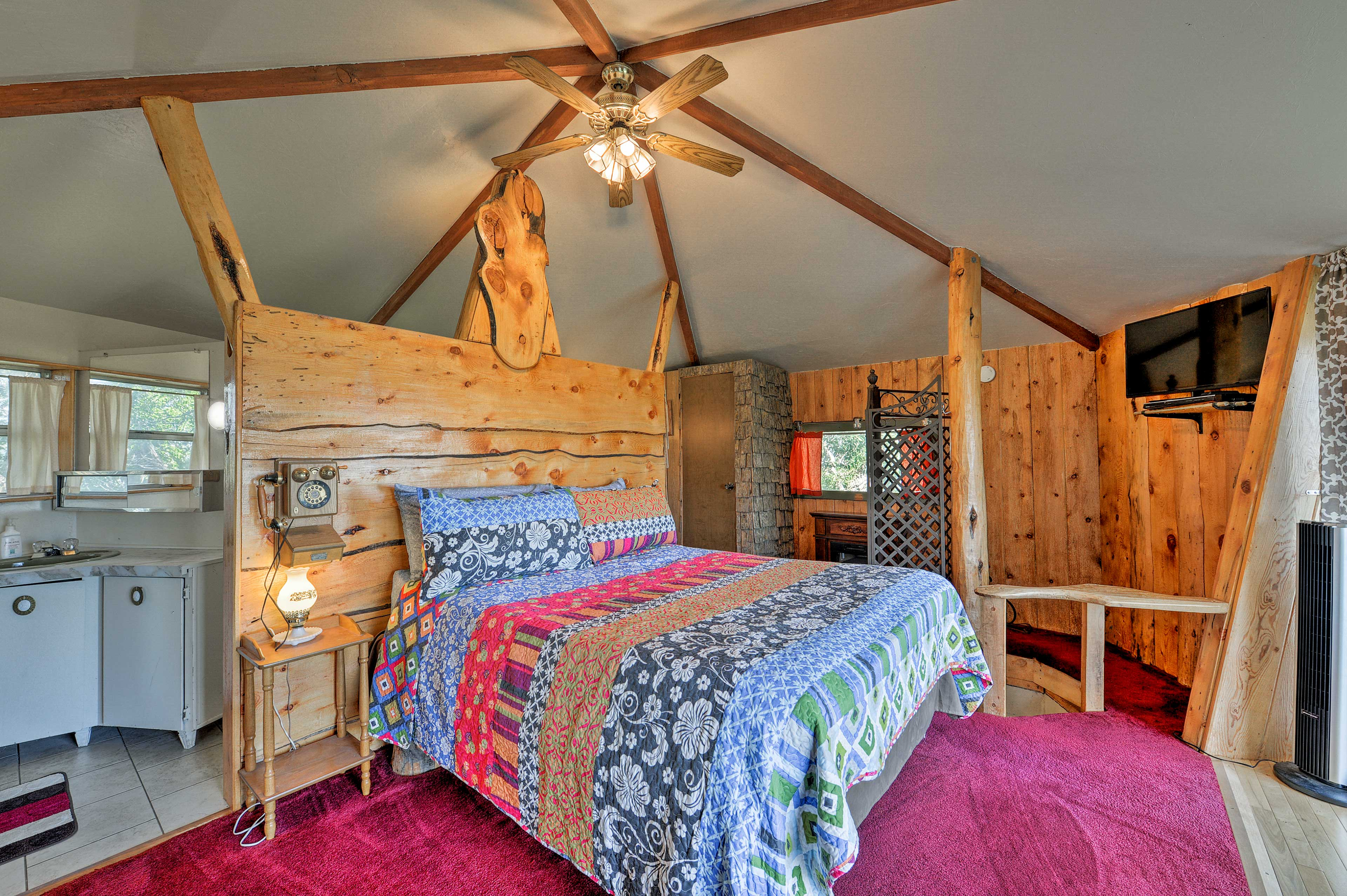 Wake up ready to explore Yellowstone National Park in the homey bedroom.