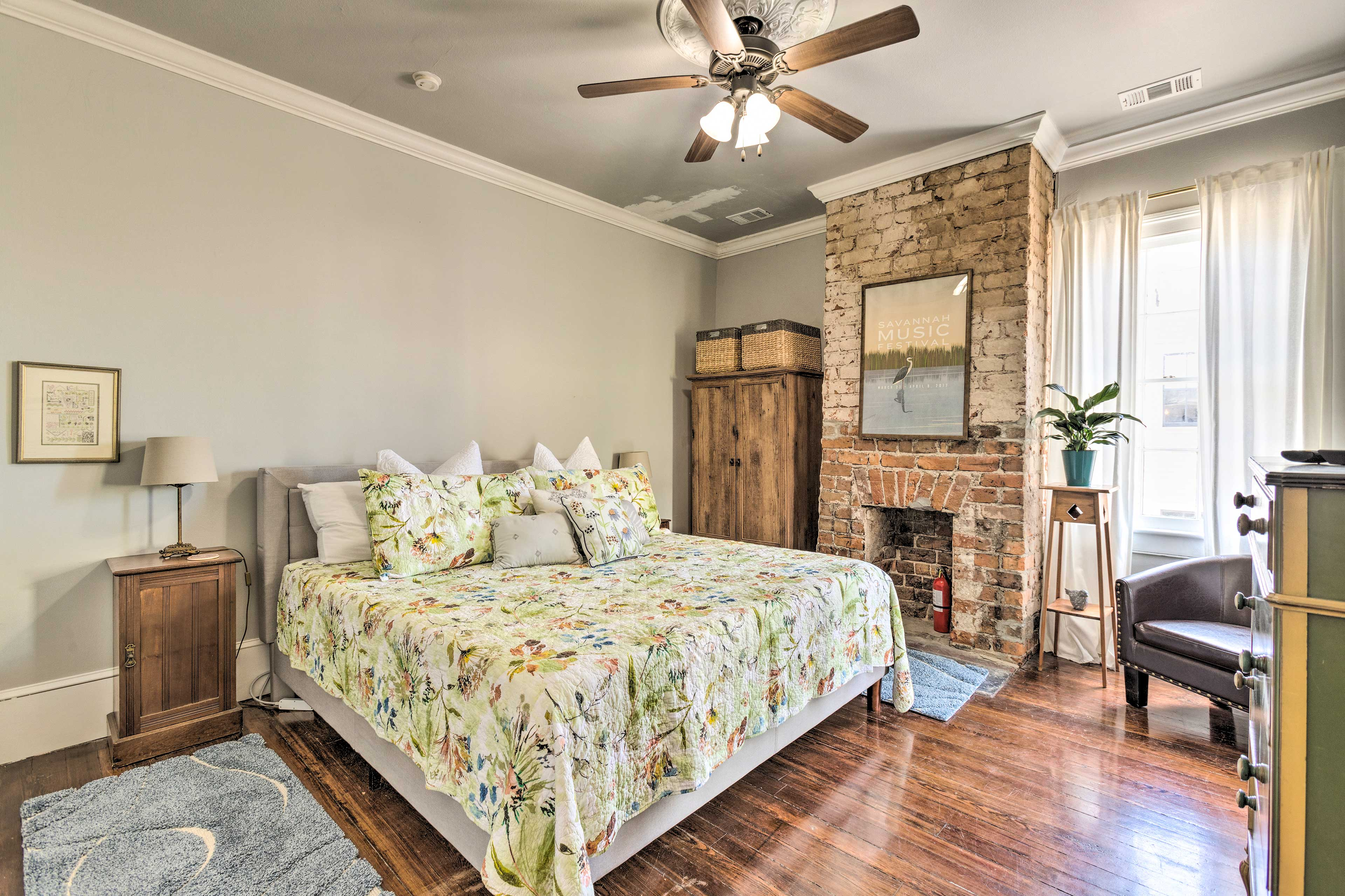 The master bedroom hosts a king-sized bed and tasteful decor.
