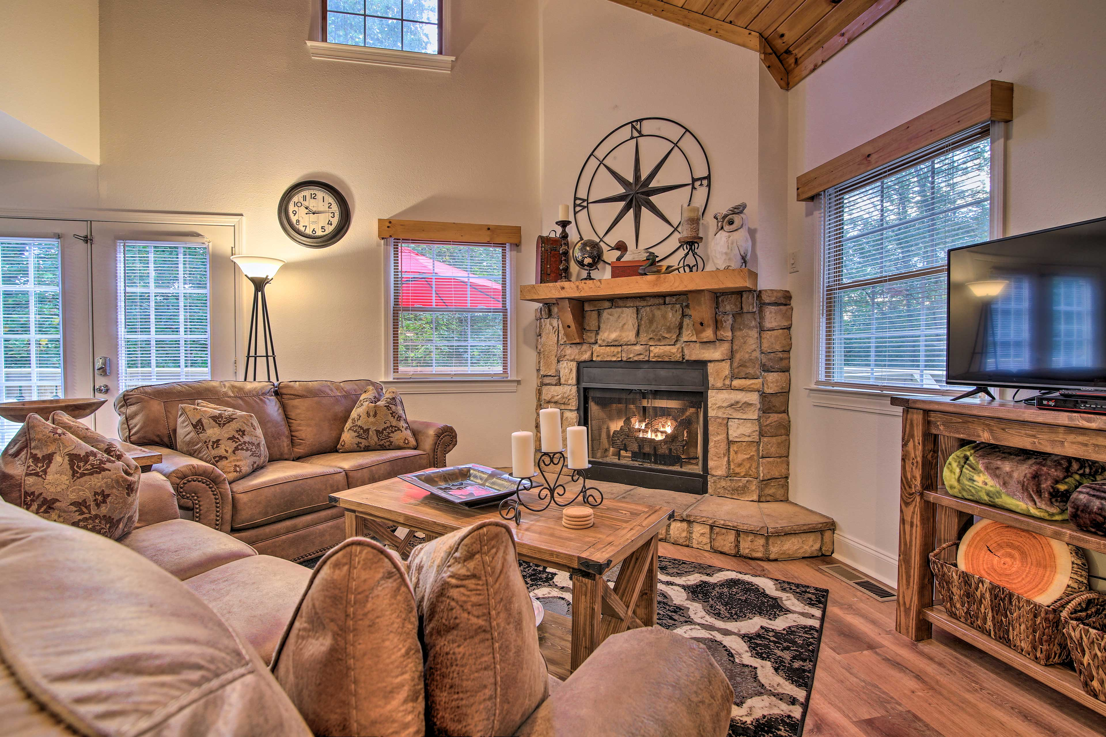 Watch a show on the flat-screen TV and cozy up by the fireplace.