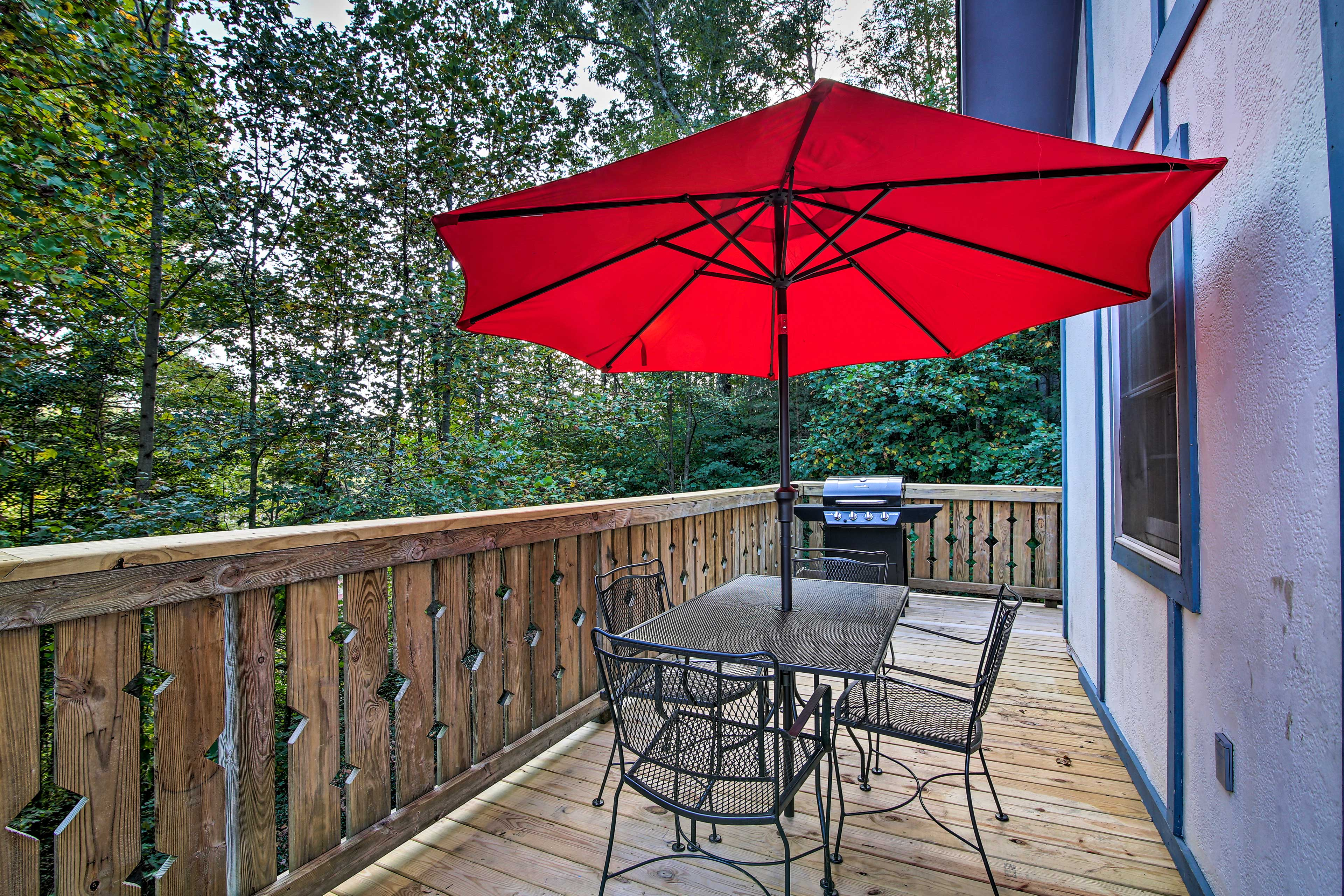 The deck includes a covered dining table.