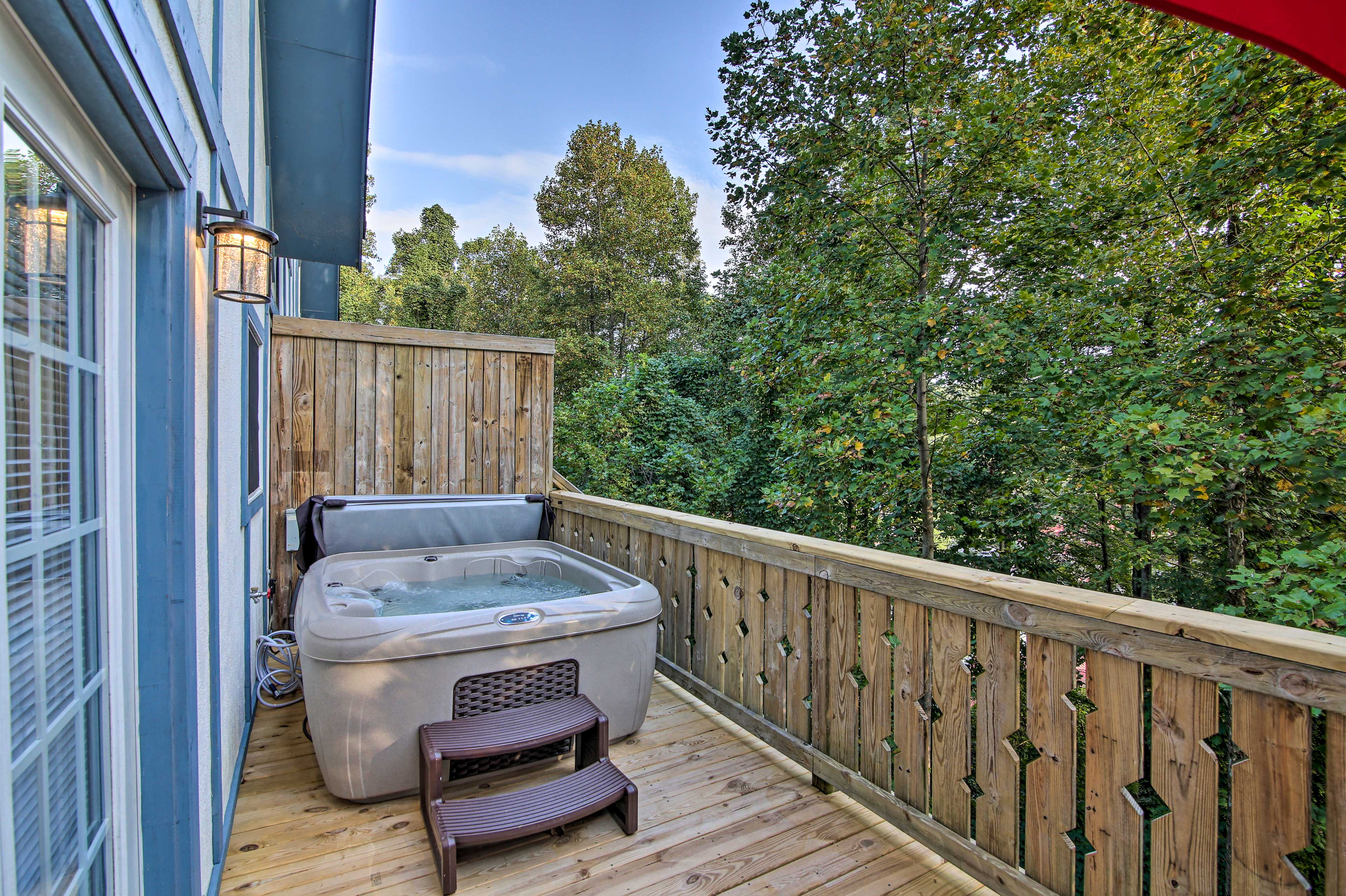 Soak your sore muscles in the private hot tub.