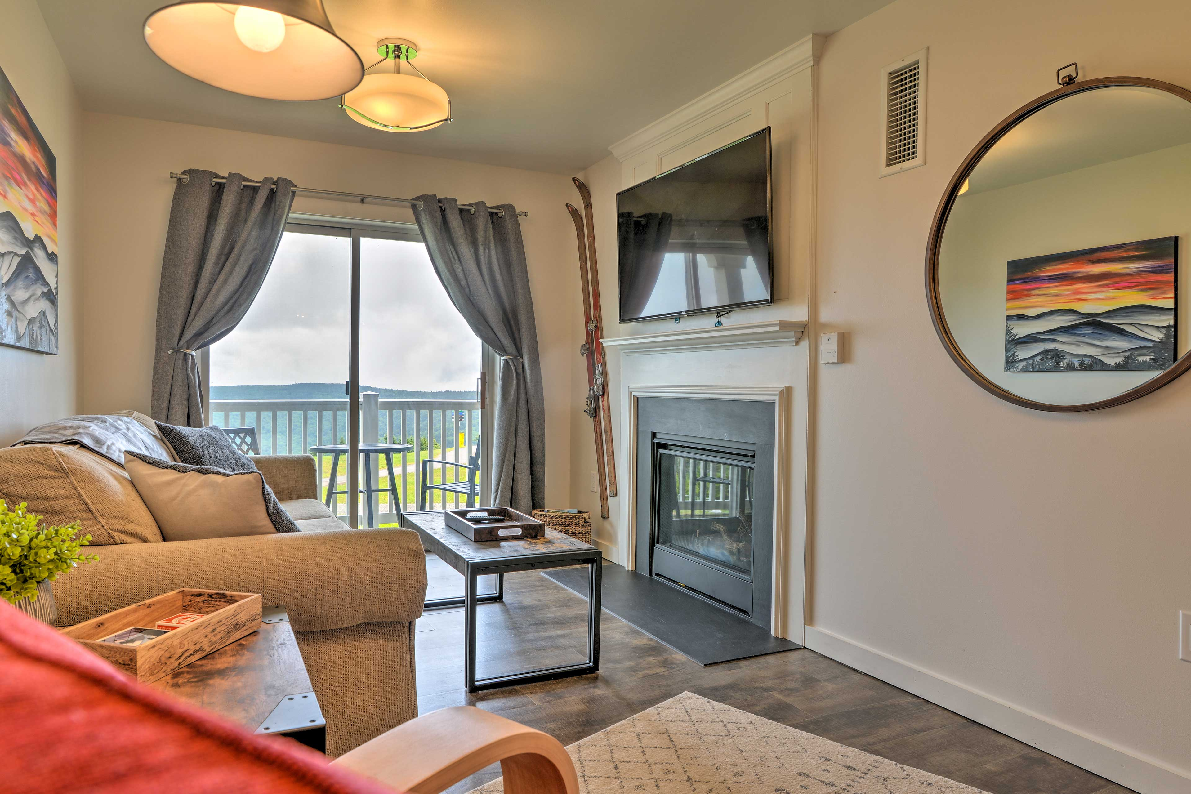 Relax in front of the flat-screen TV and gas fireplace.