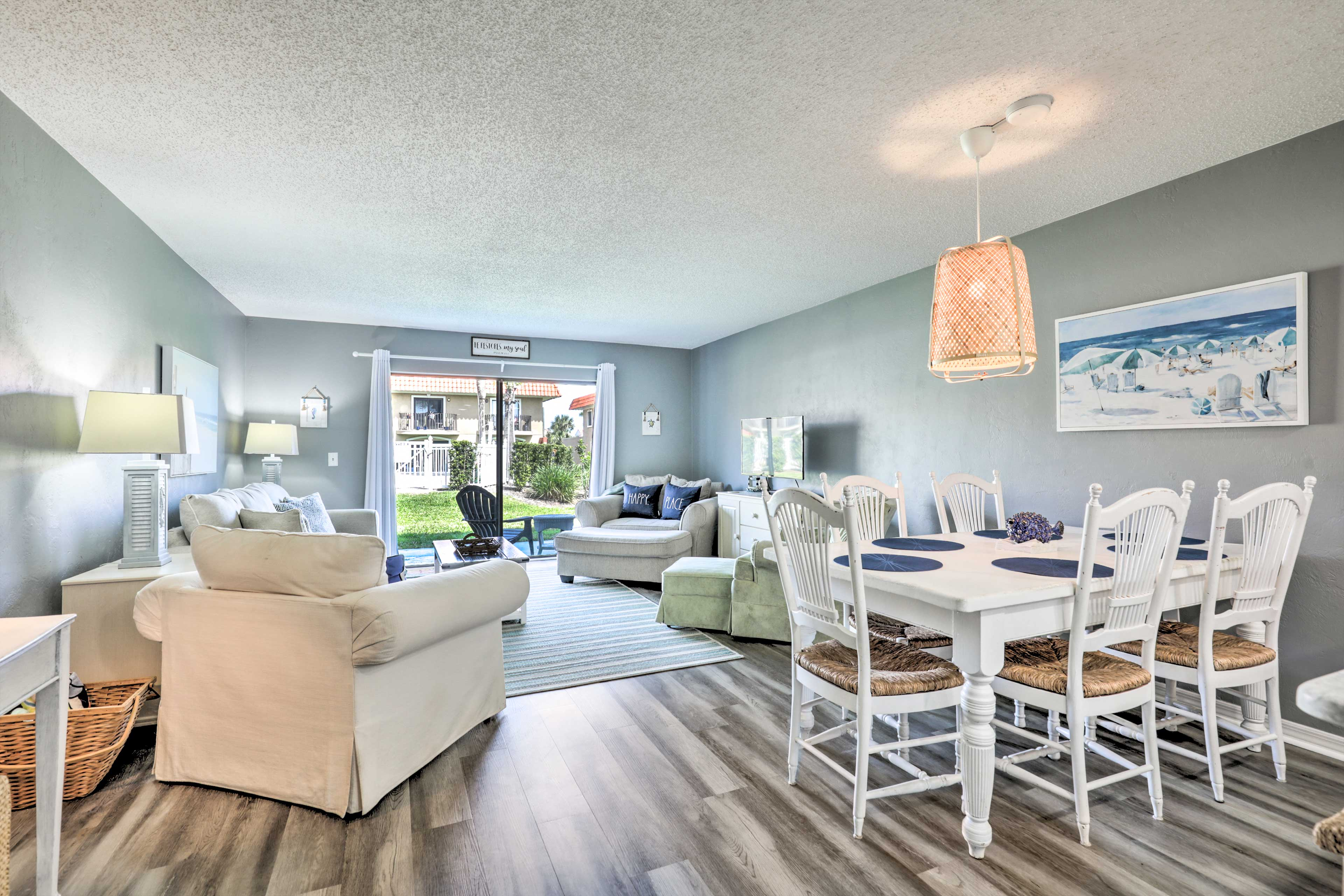 Natural light illuminates the spacious living area featuring ideal amenities.