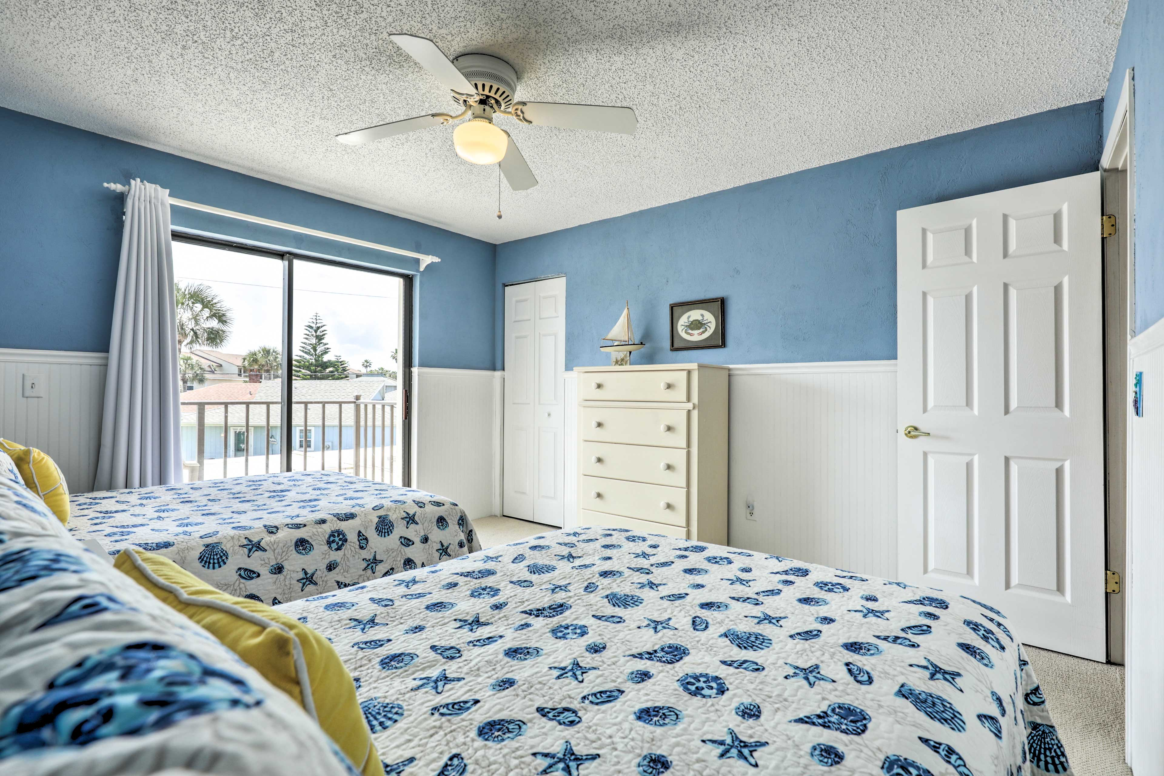 The second bedroom's 2 full beds easily sleeps 4 guests.