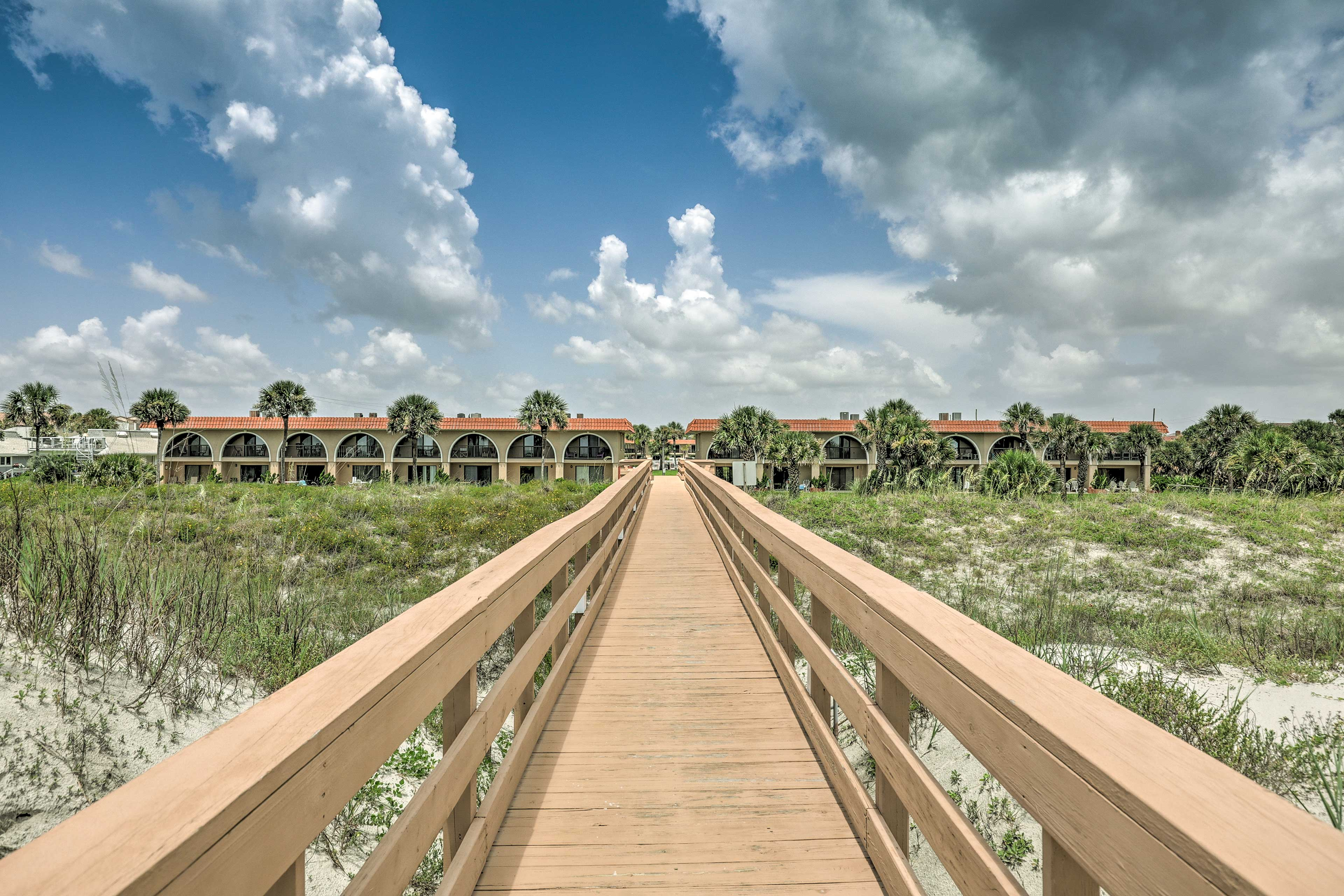 The beach lies a quick boardwalk away from the vacation rental.