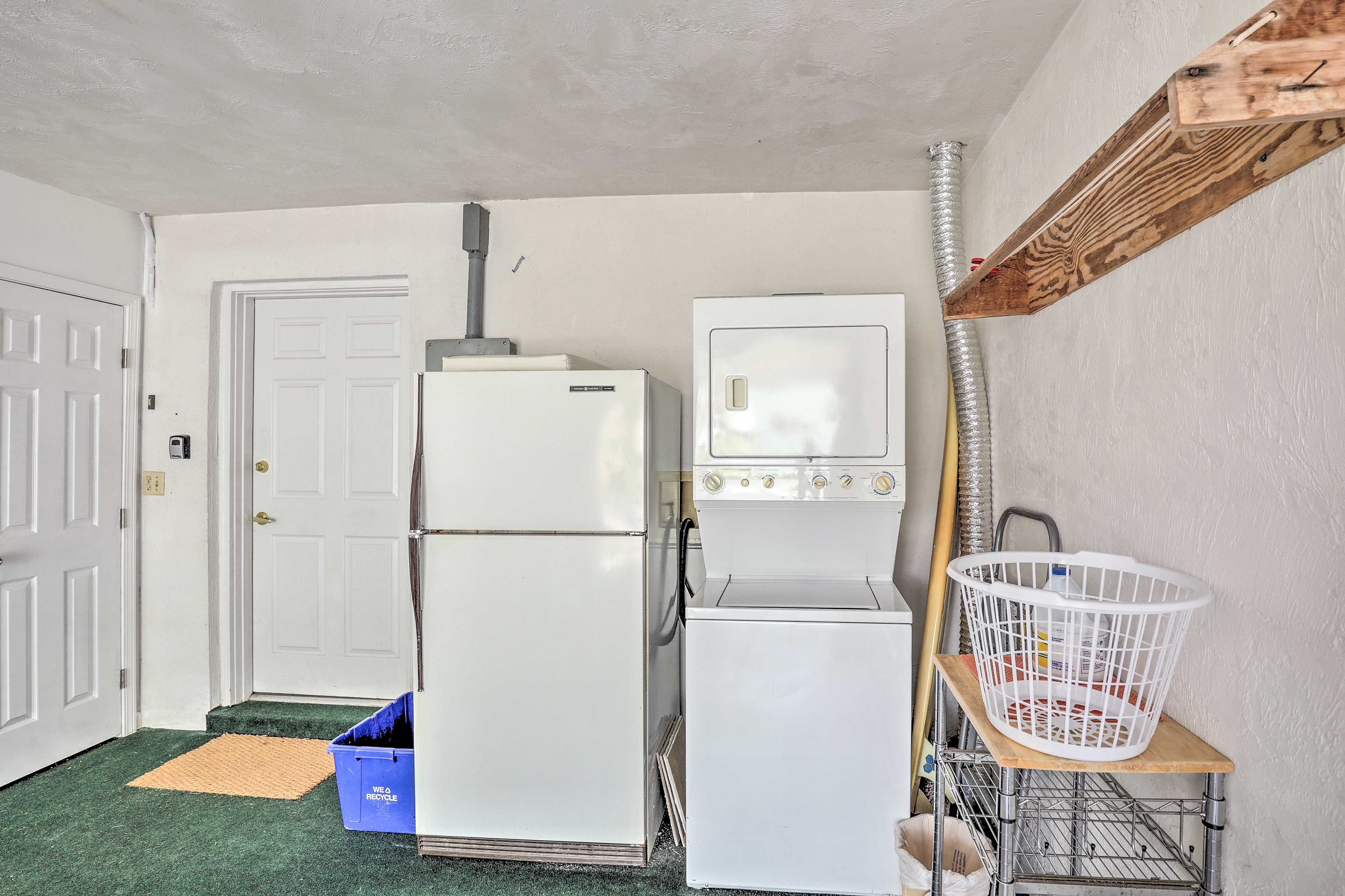 You'll find a second refrigerator & the laundry machines also in the garage.