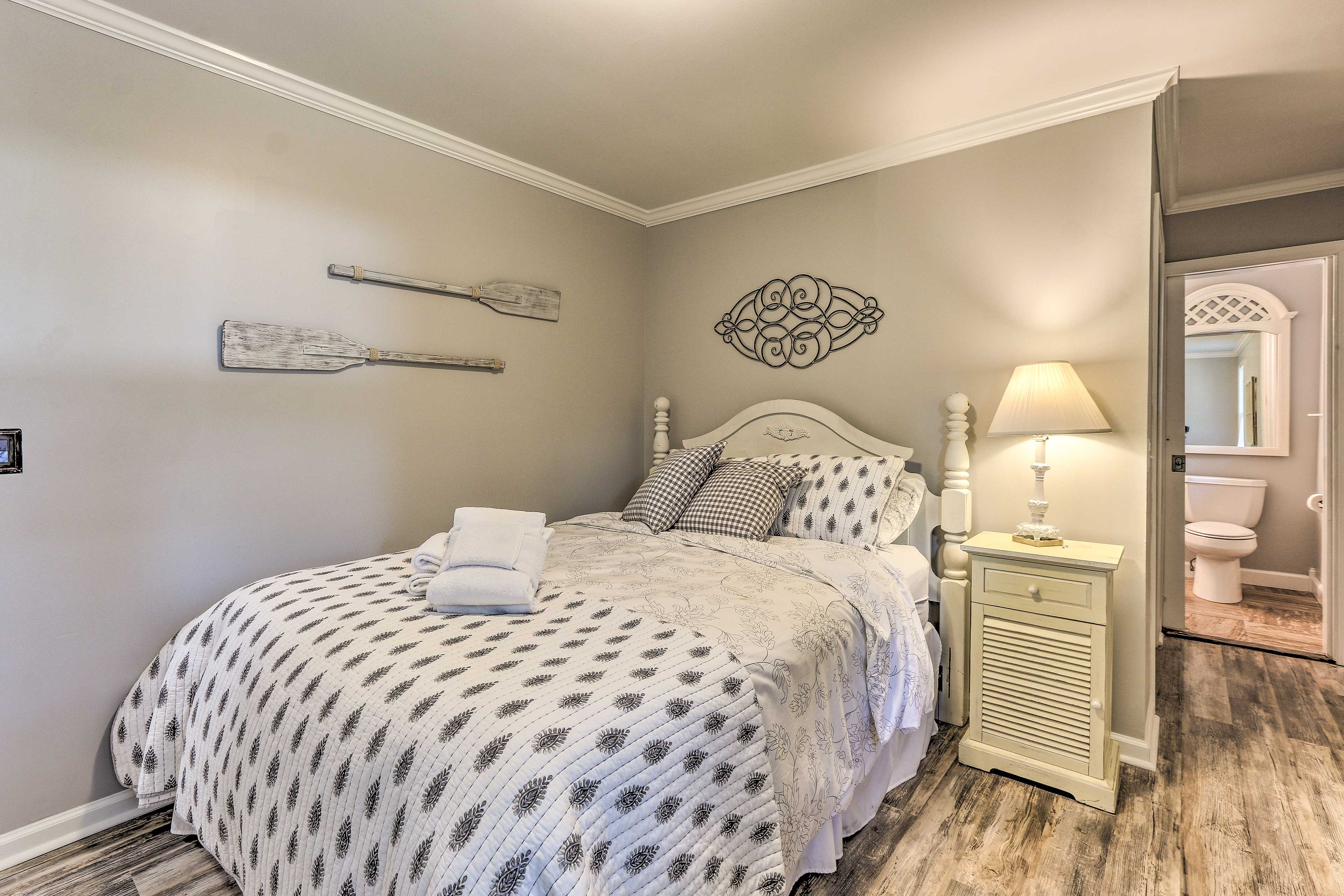 The master bedroom boasts a queen bed and an en-suite bath.