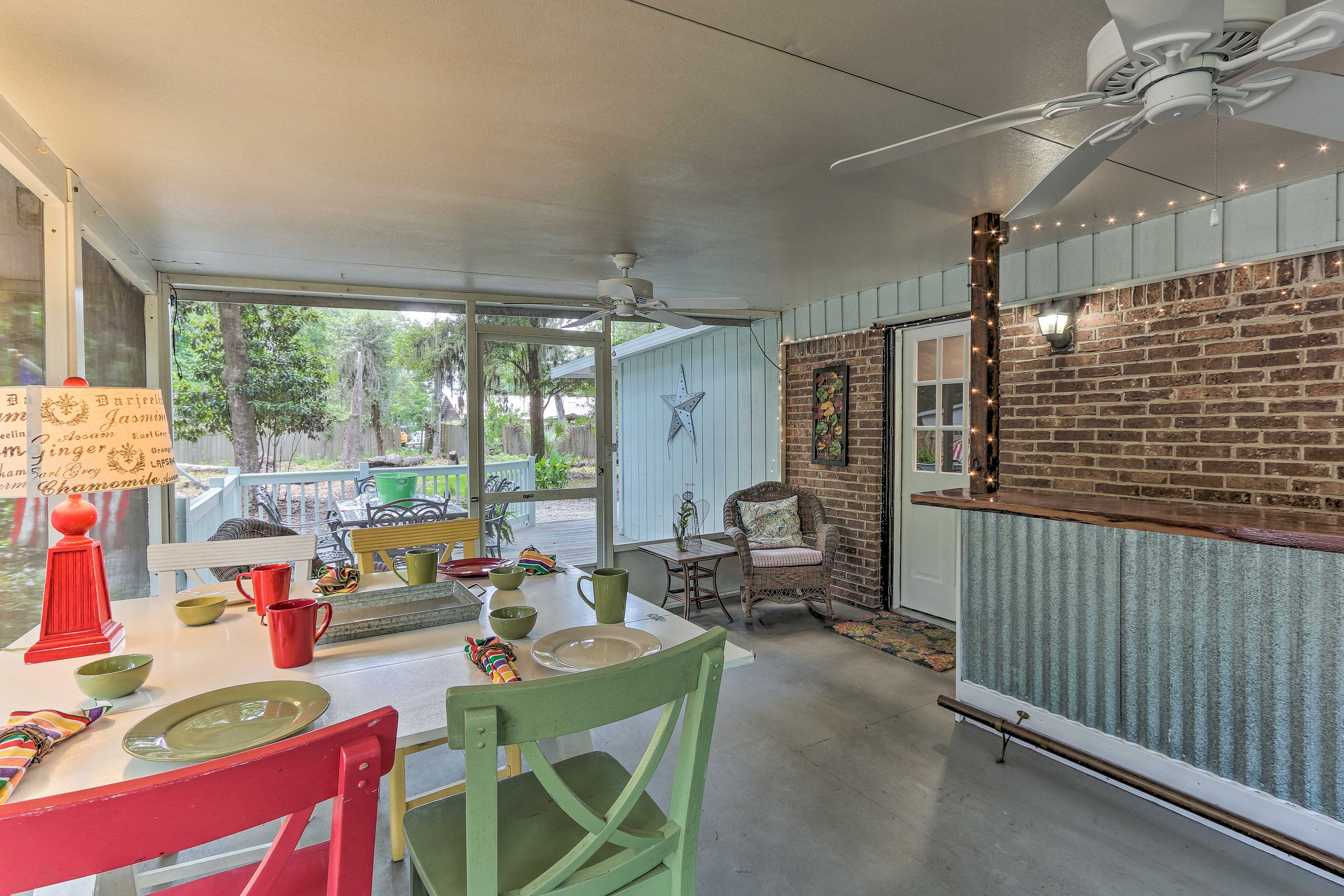 The screened-in porch is the perfect place to spend your time.