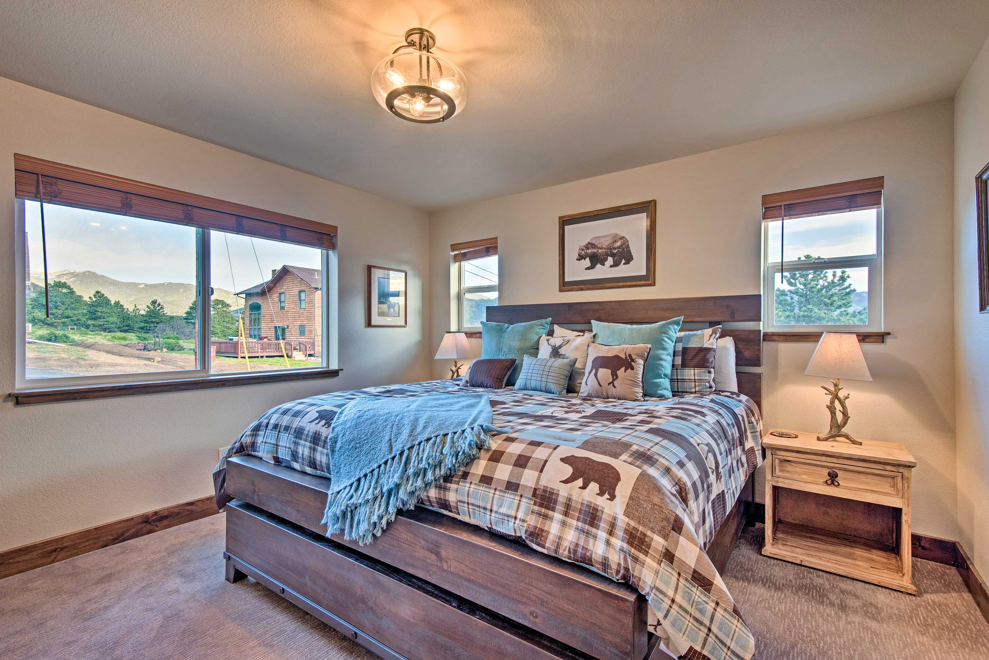 Northwoods decor and wood furnishings bring the master bedroom to life.