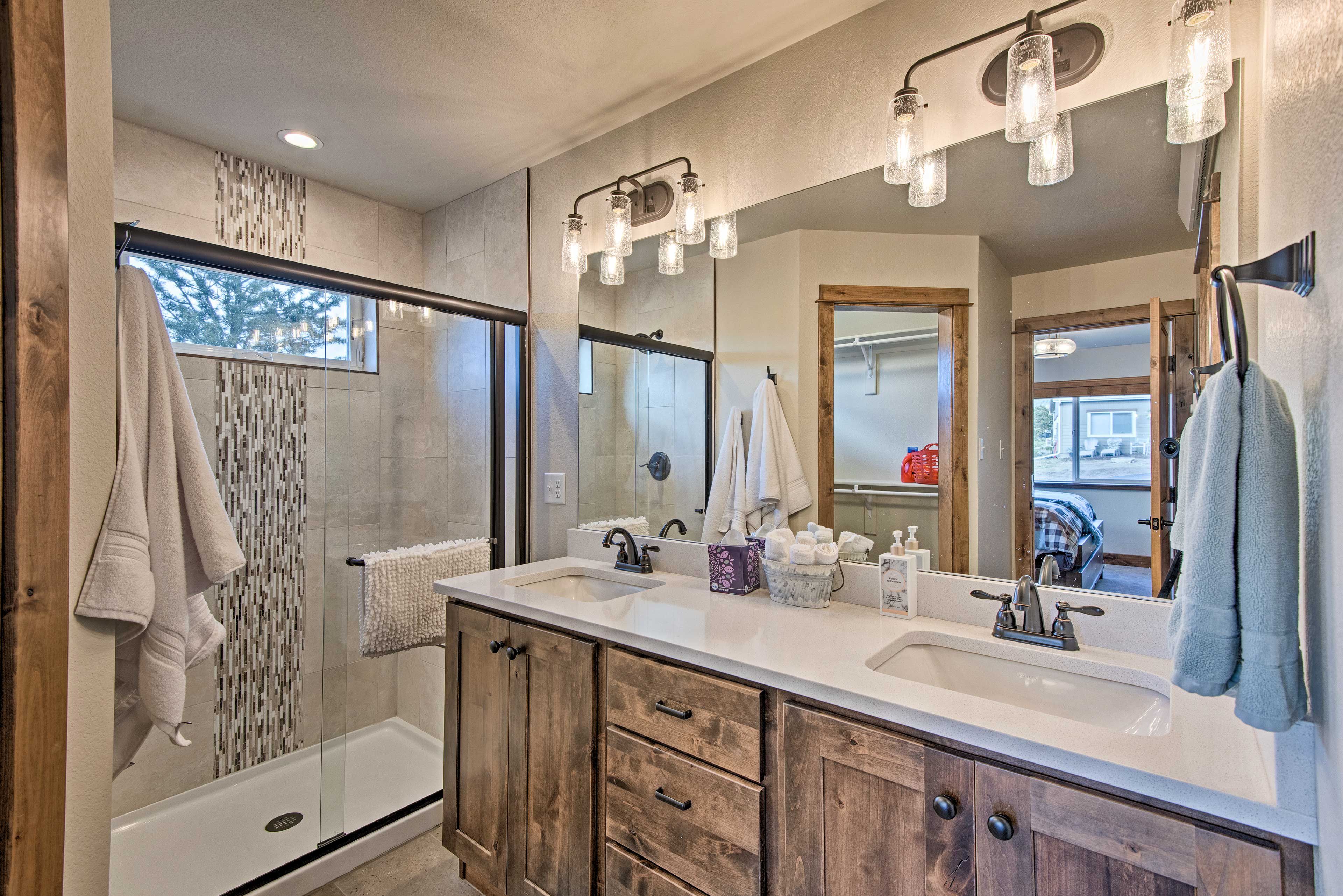 This spacious en-suite bathroom includes double sinks and a walk-in closet.