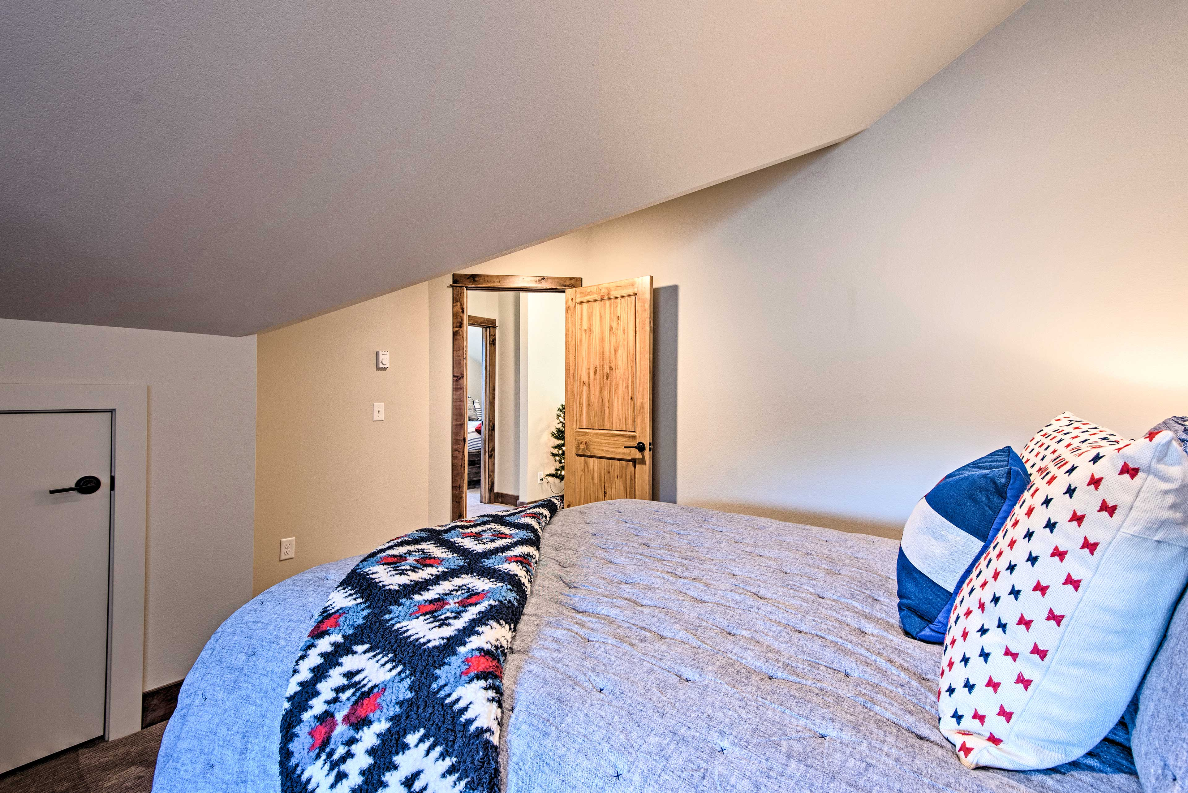 The room features a queen bed and futon.