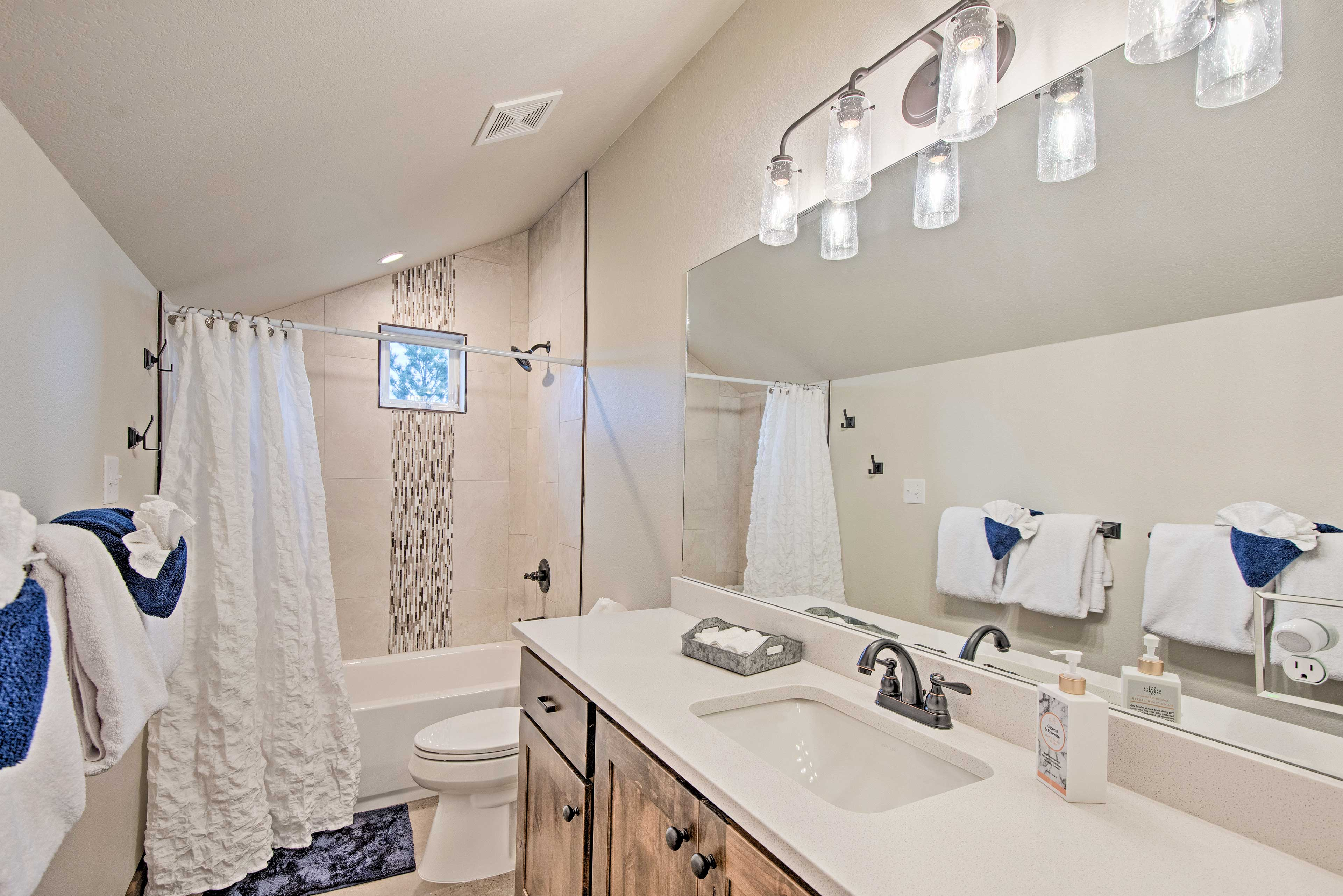 Rinse and refresh in this pristine bathroom!