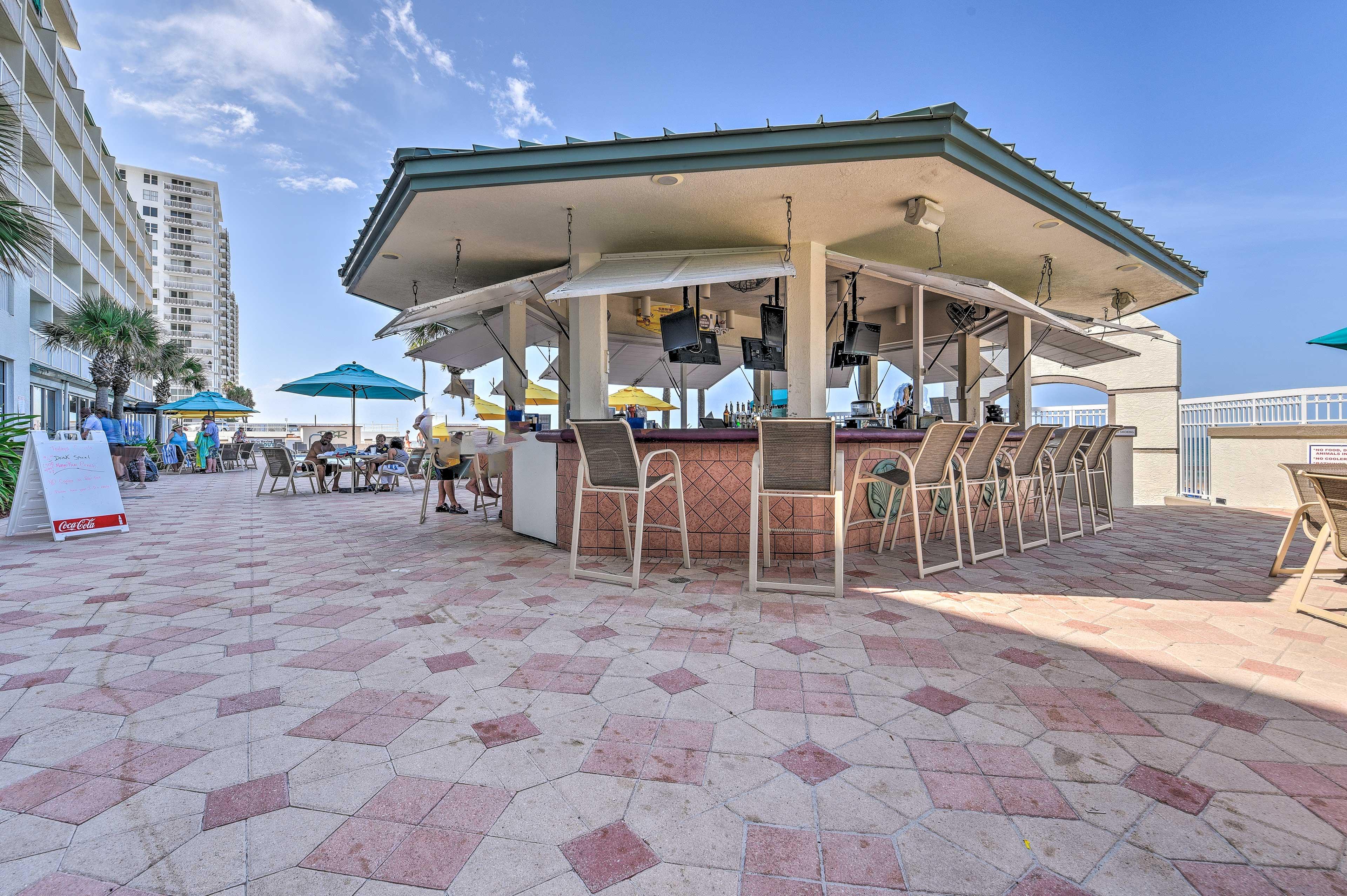 Grab a cold drink at the tiki bar.