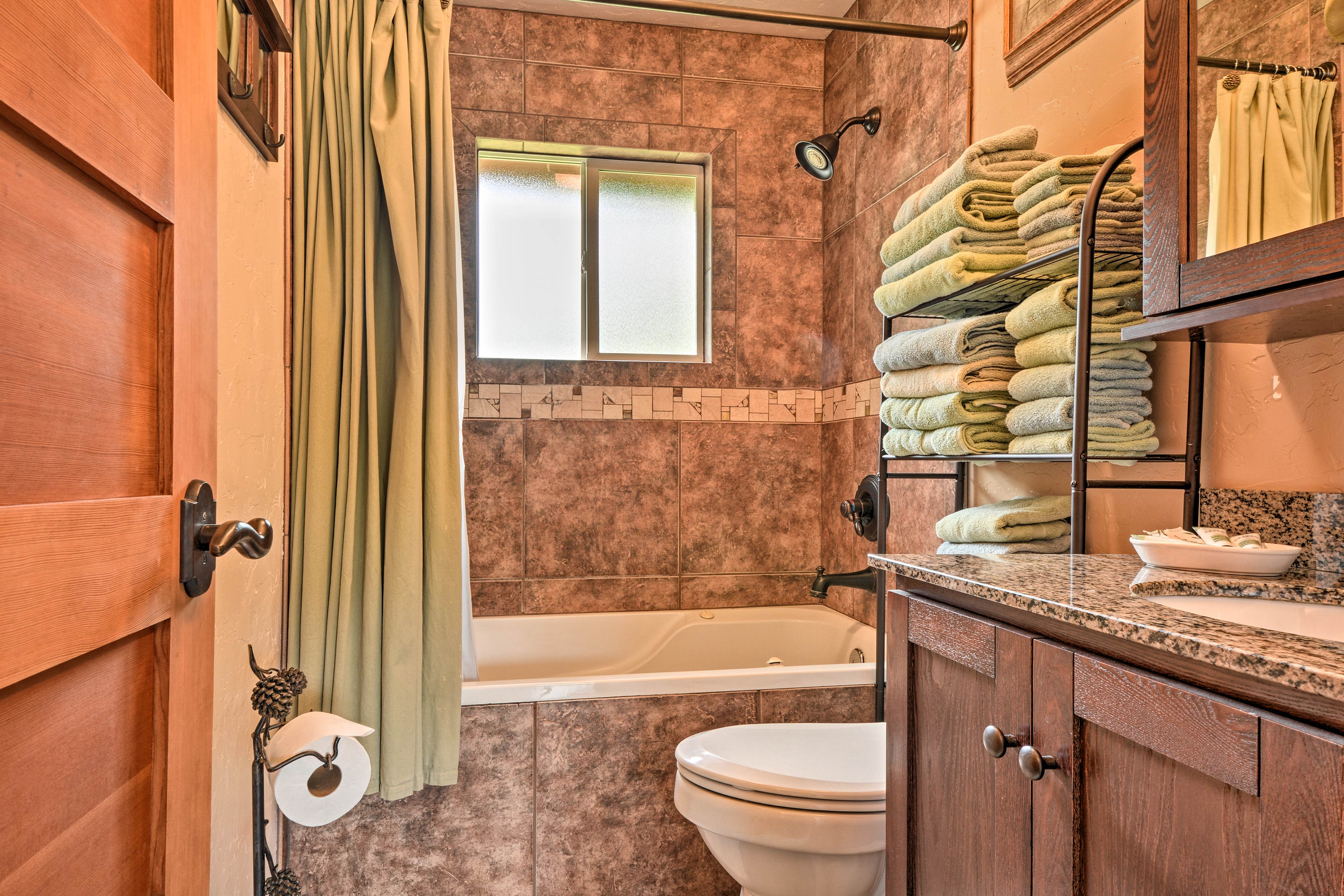 Find fresh towels awaiting your arrival in the bathroom.