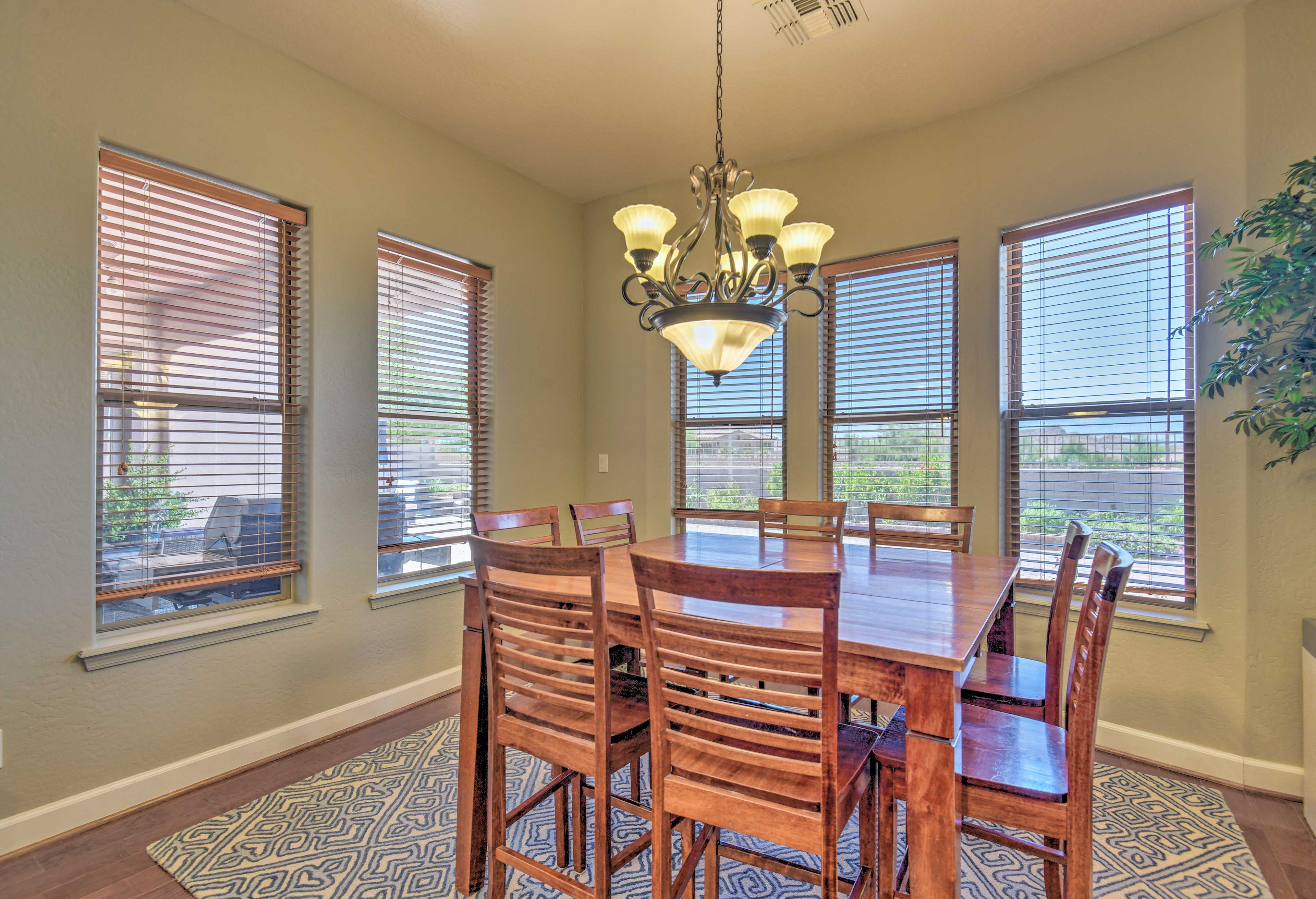 Large windows surround the dining table.
