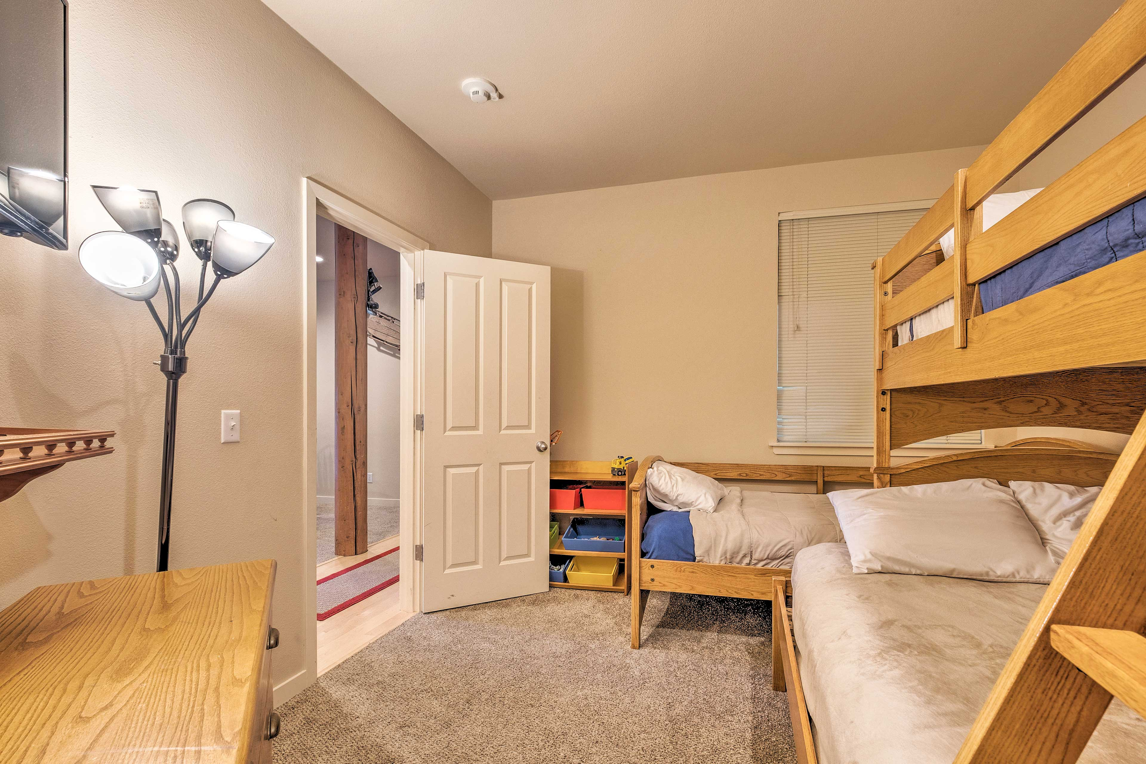 The room offers a twin bed, twin-over-full bunk set and cable TV.