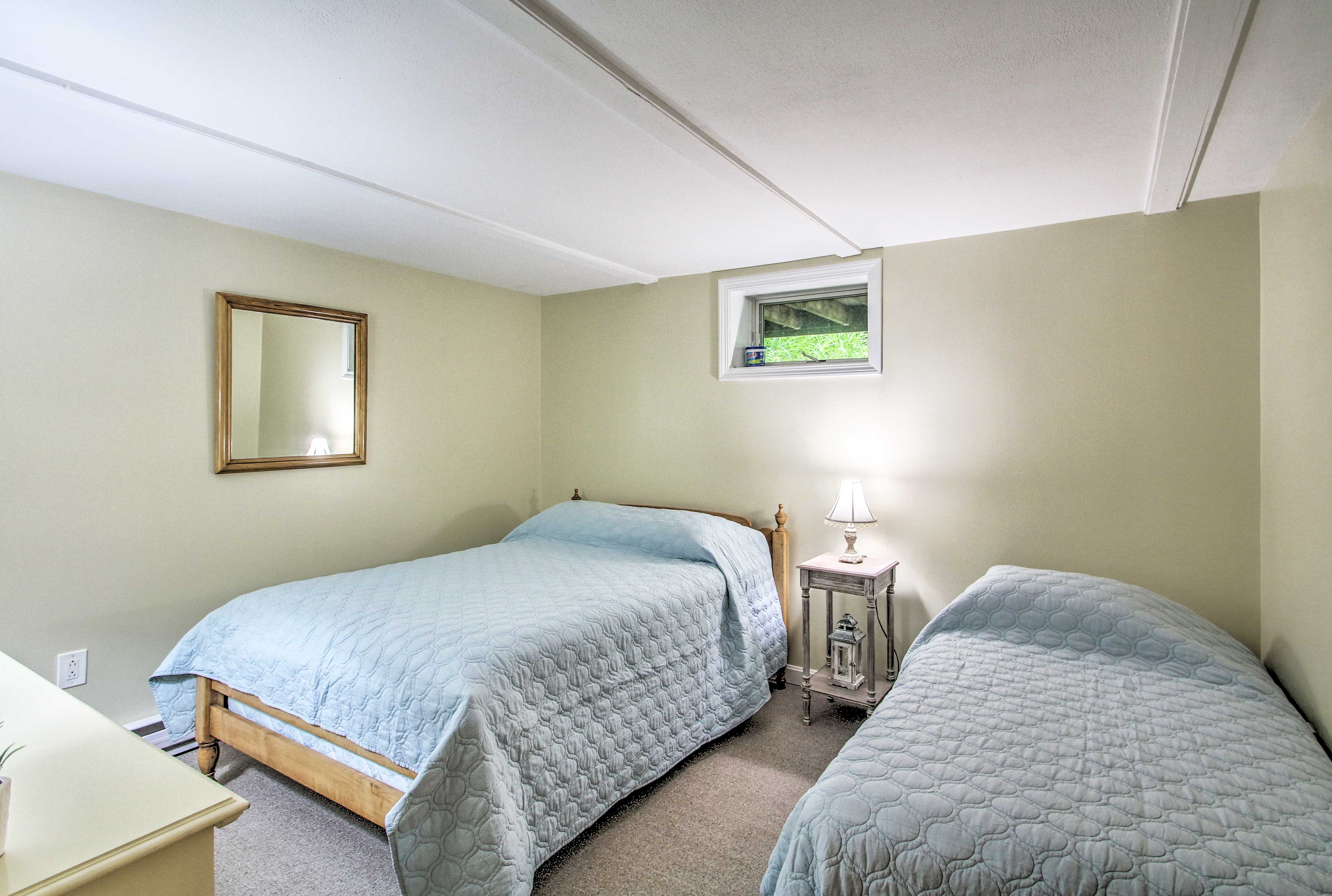 The second bedroom features a full and twin-sized bed.