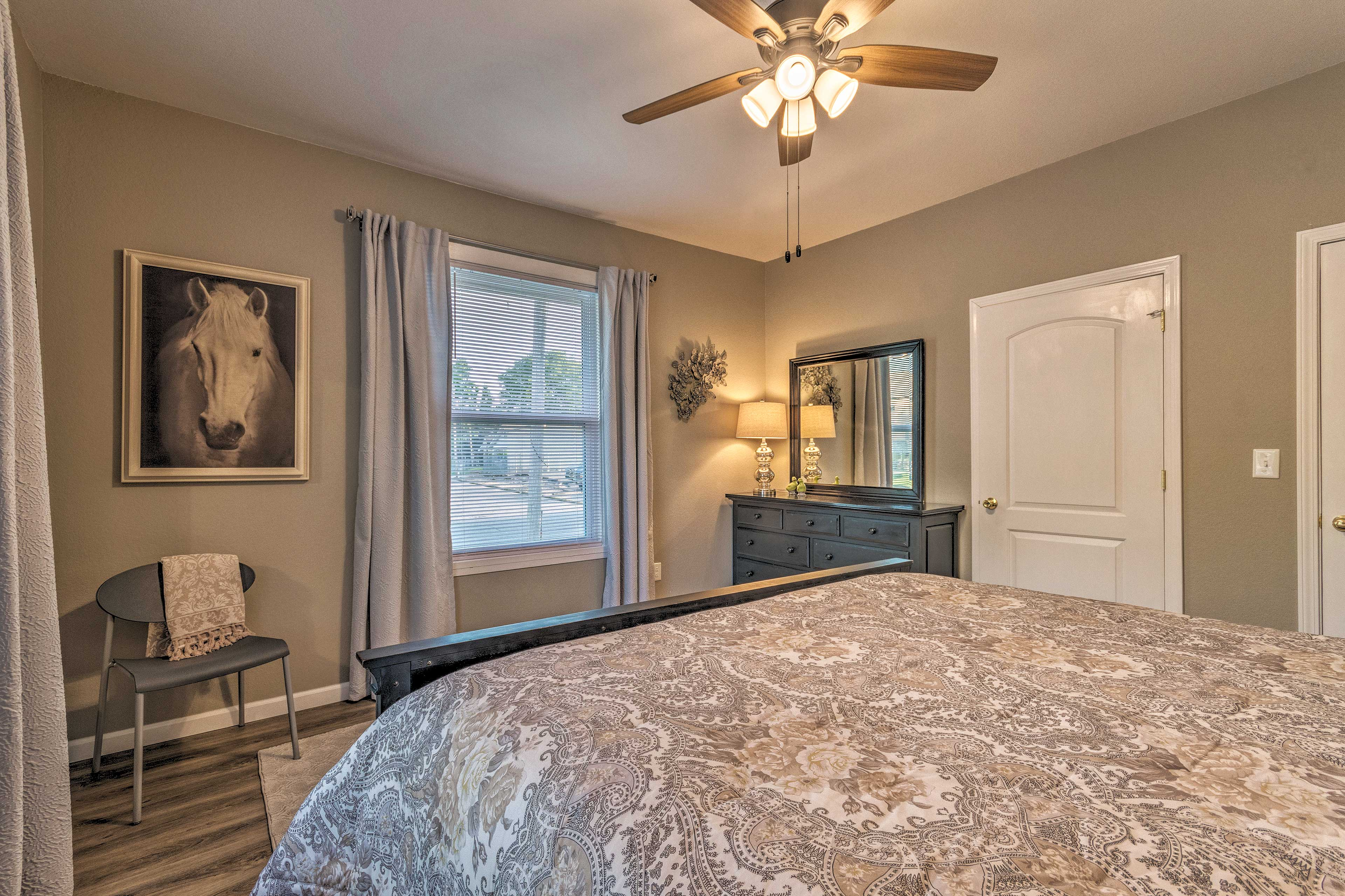 Enjoy the breeze of the ceiling fan from the king bed.