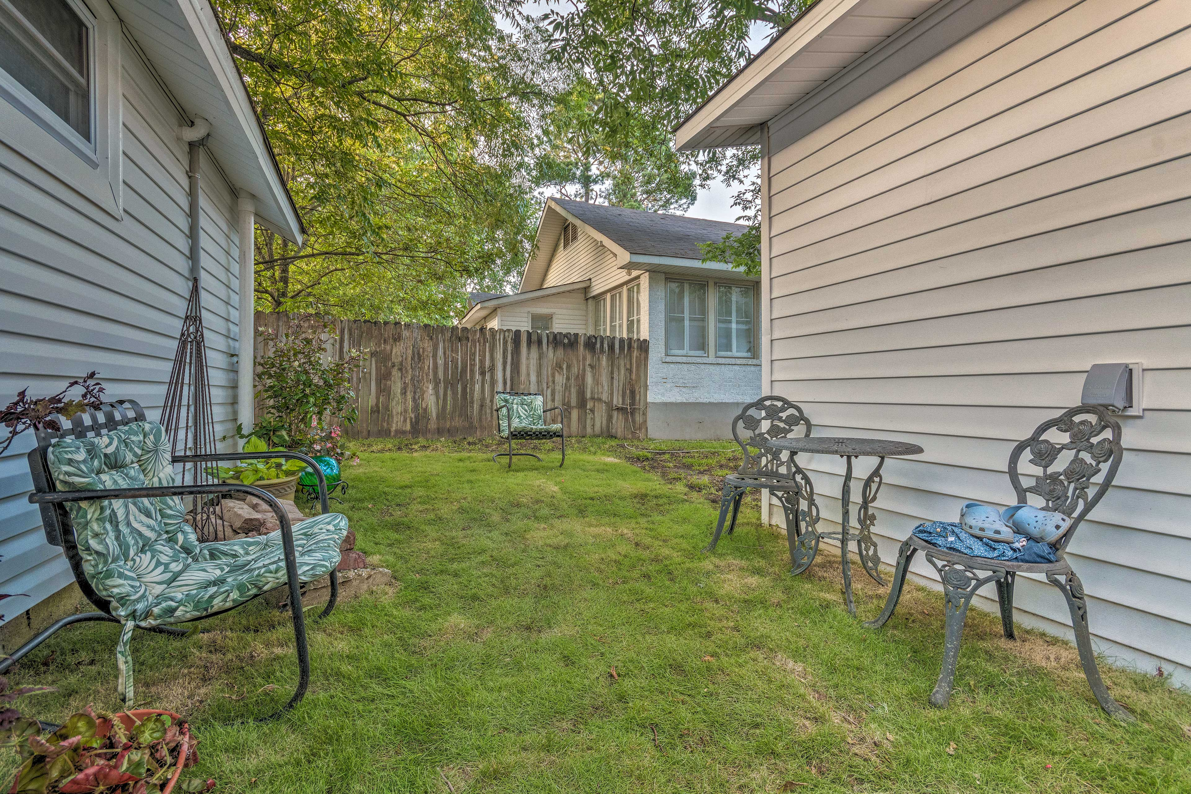 The yard offers a privacy fence.