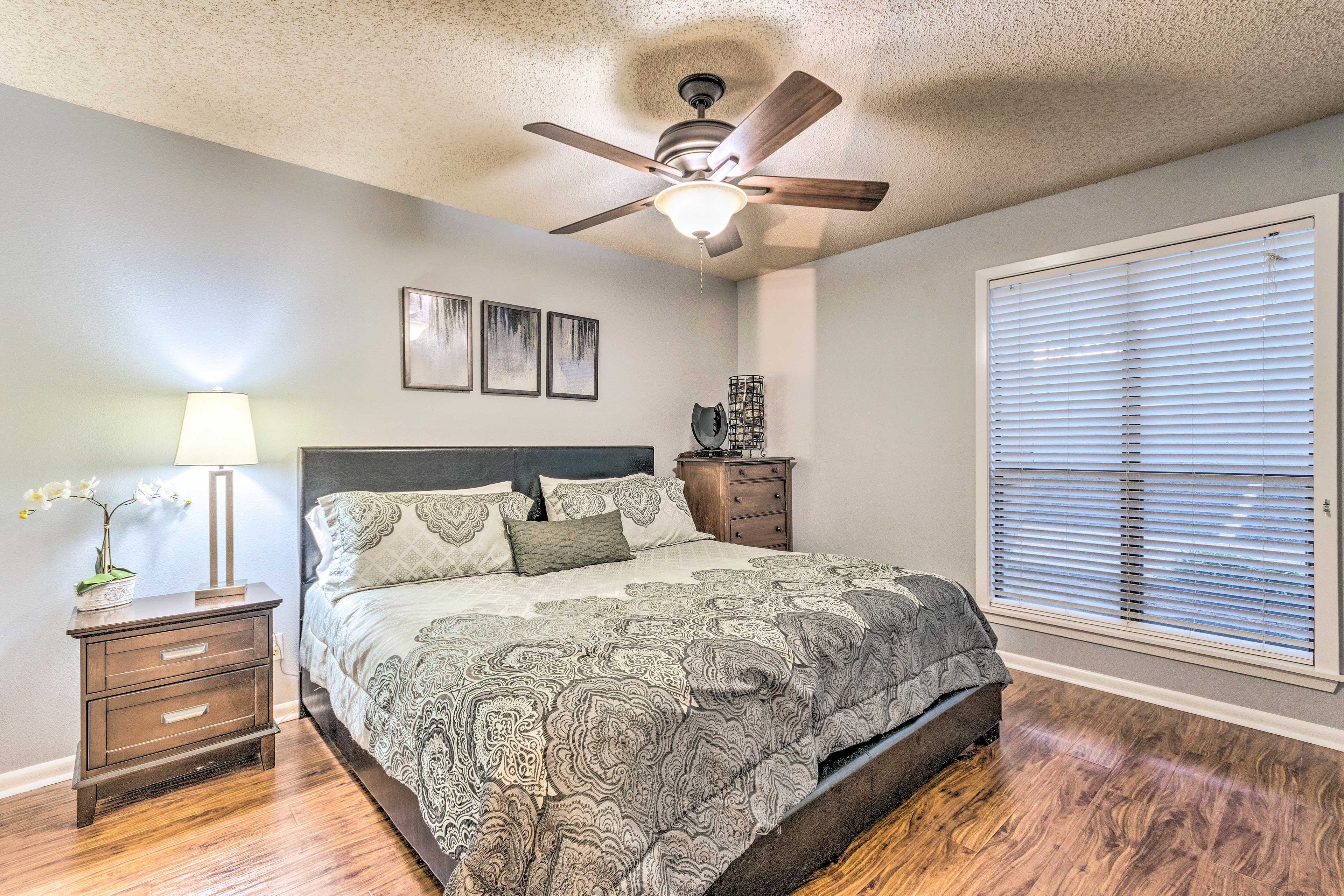 The second bedroom stands apart with a king-sized bed.