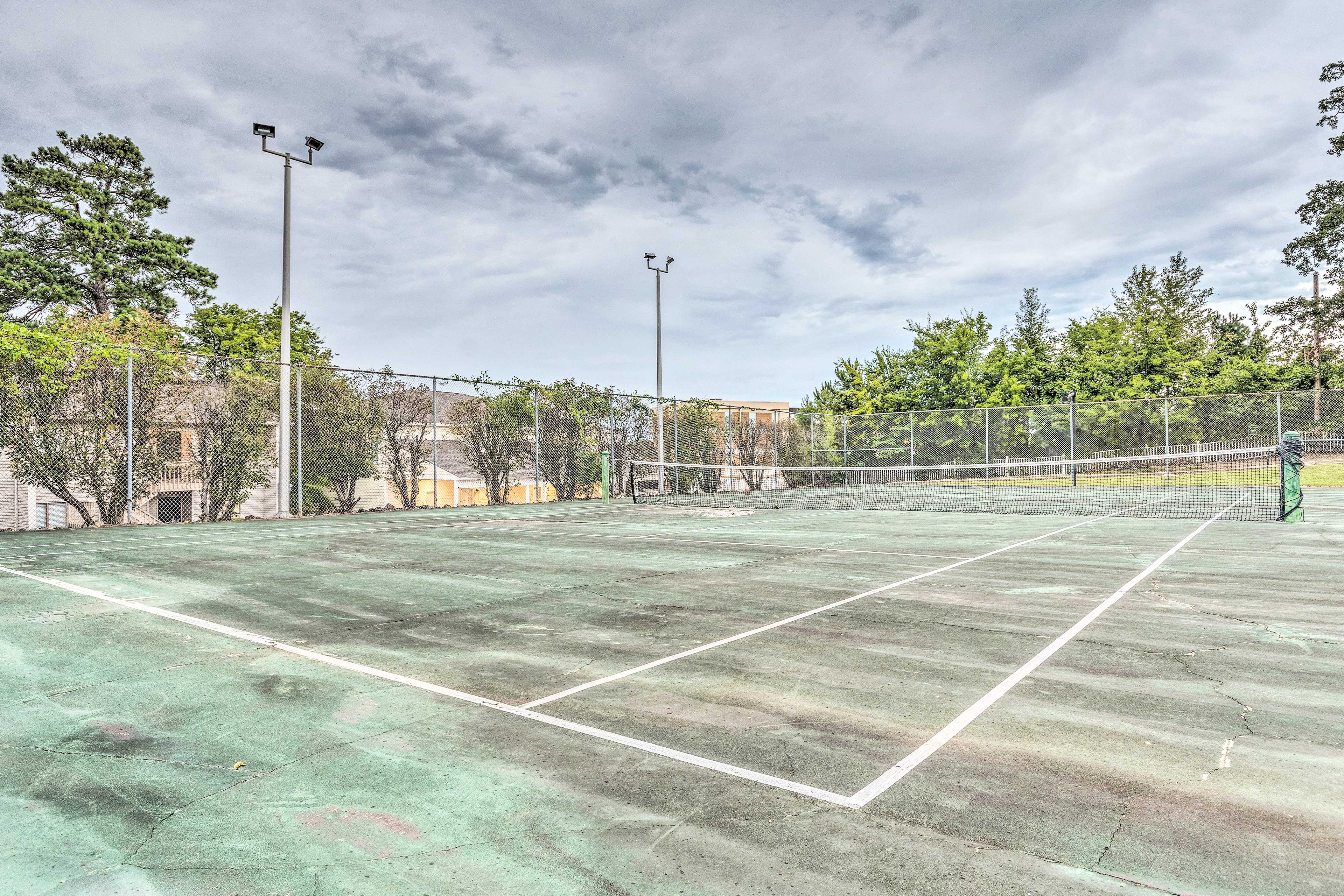 Community amenities include a tennis court, pool, dock access and more!