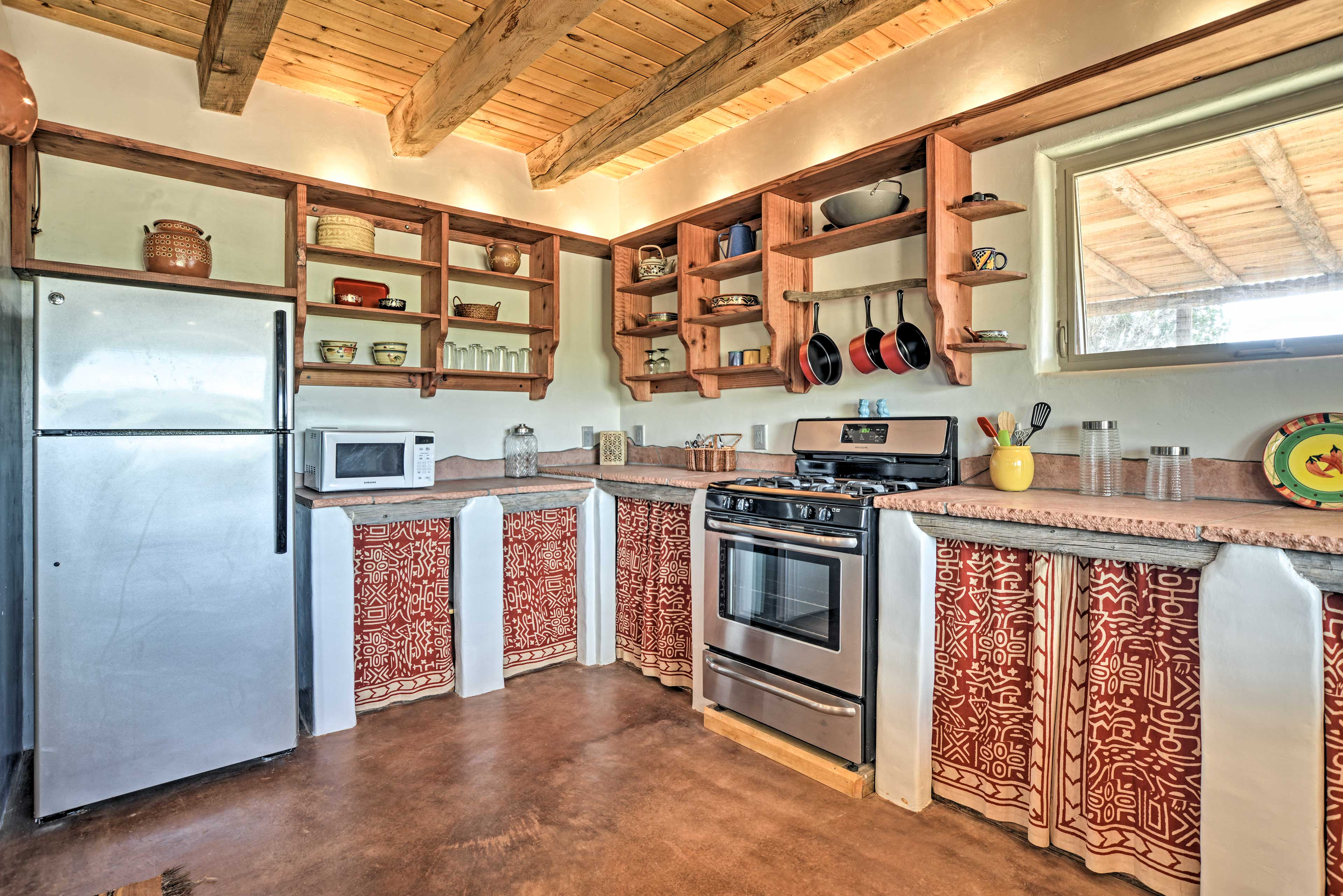 Stainless steel appliances elevate the space.