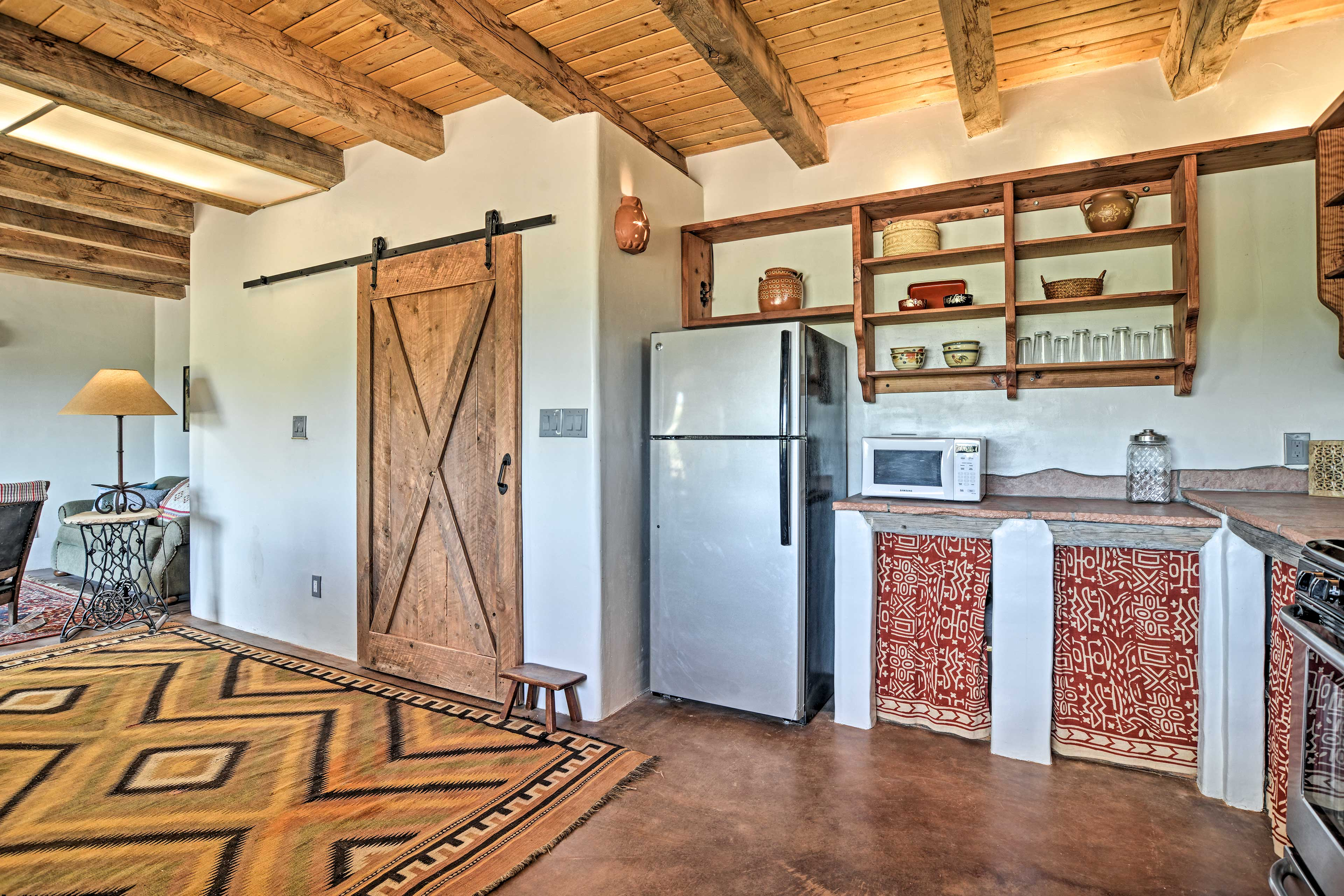 The kitchen comes fully equipped for your convenience.