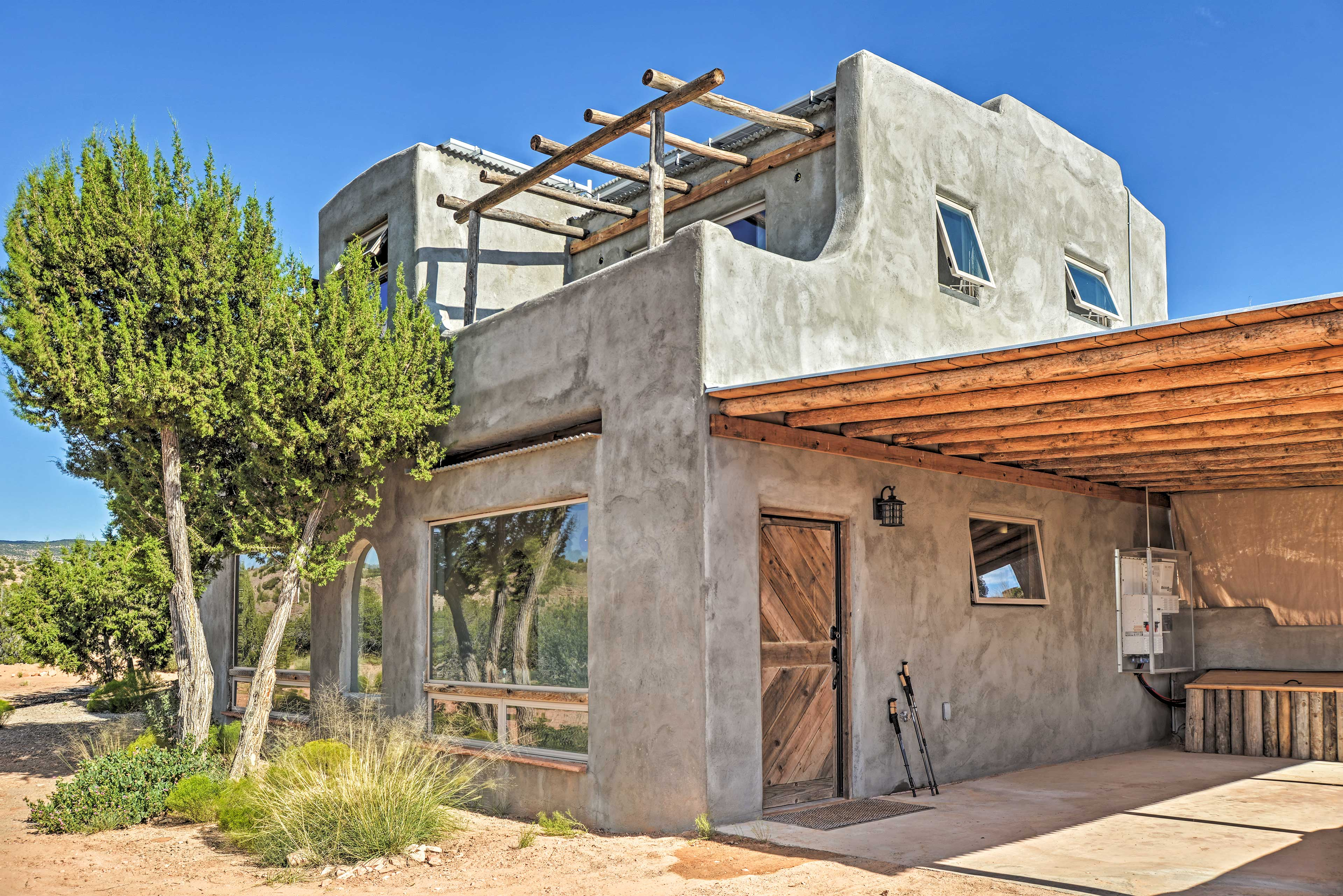 This vacation rental features a Southwestern-style exterior.