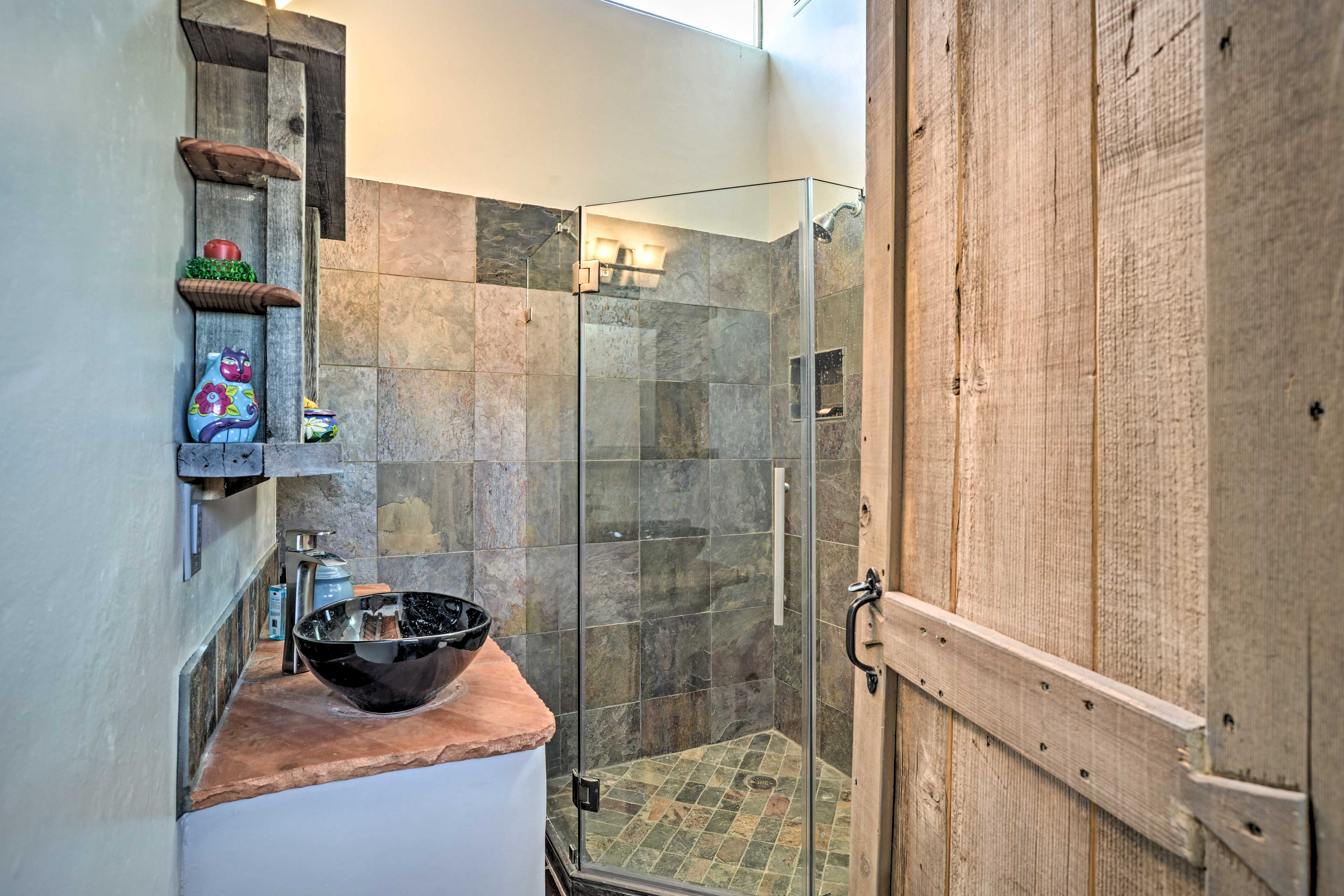 The second full bathroom features another walk-in shower.