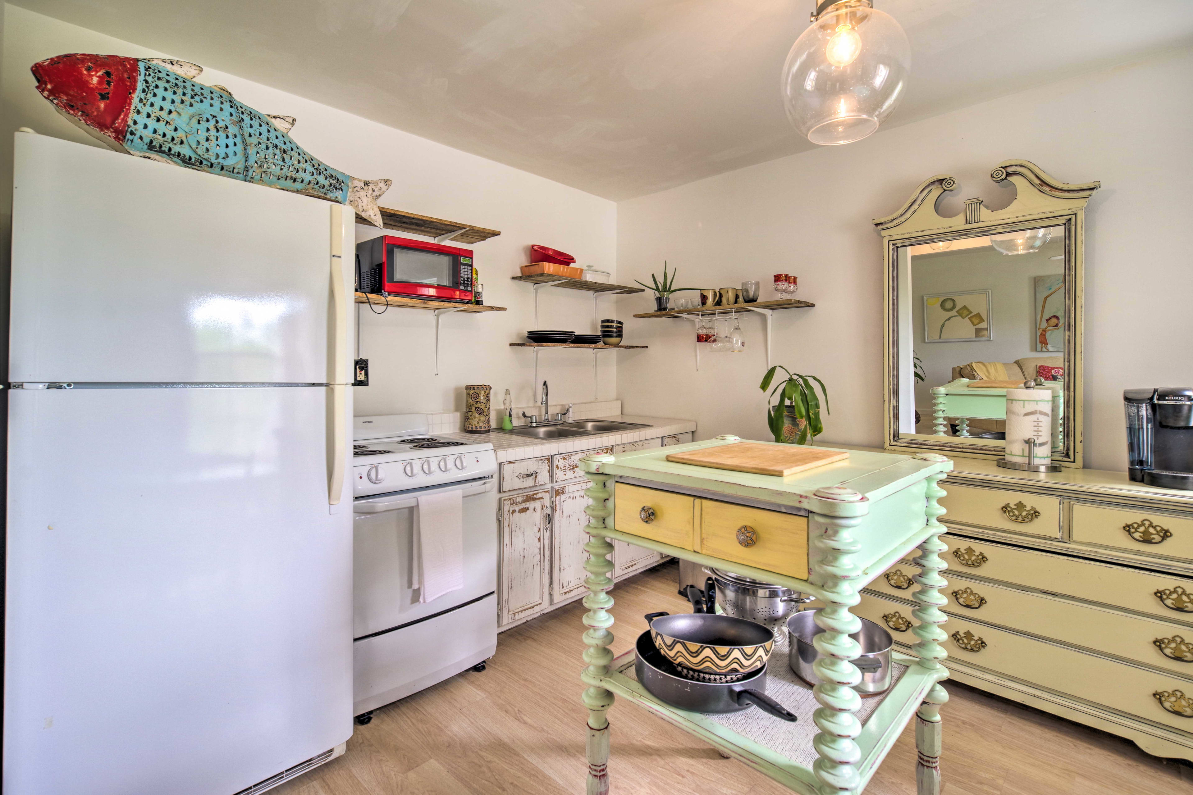 The kitchen is equipped with all appliances necessary.