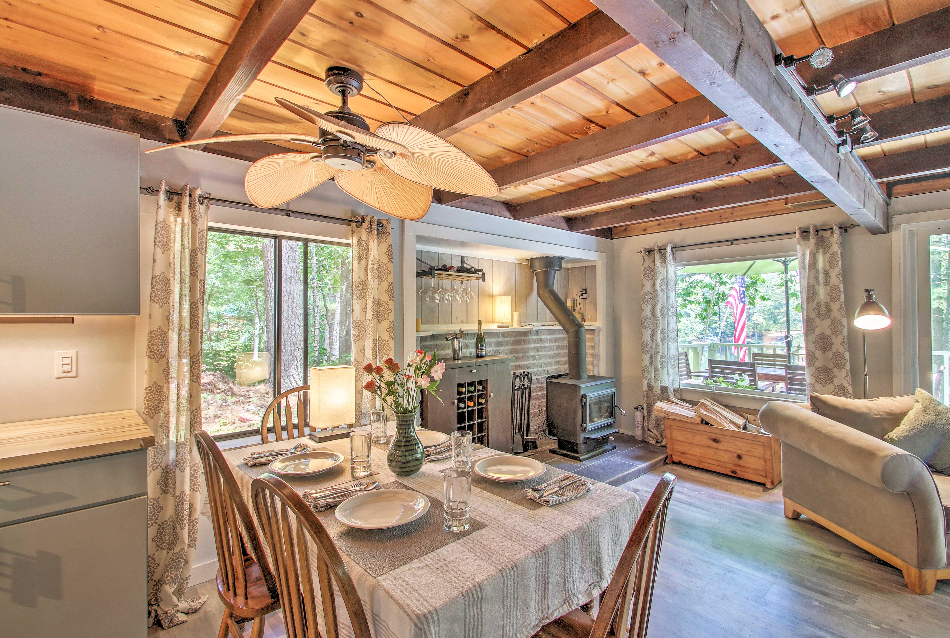 Look up at exposed-beam ceilings in this traditional cabin.