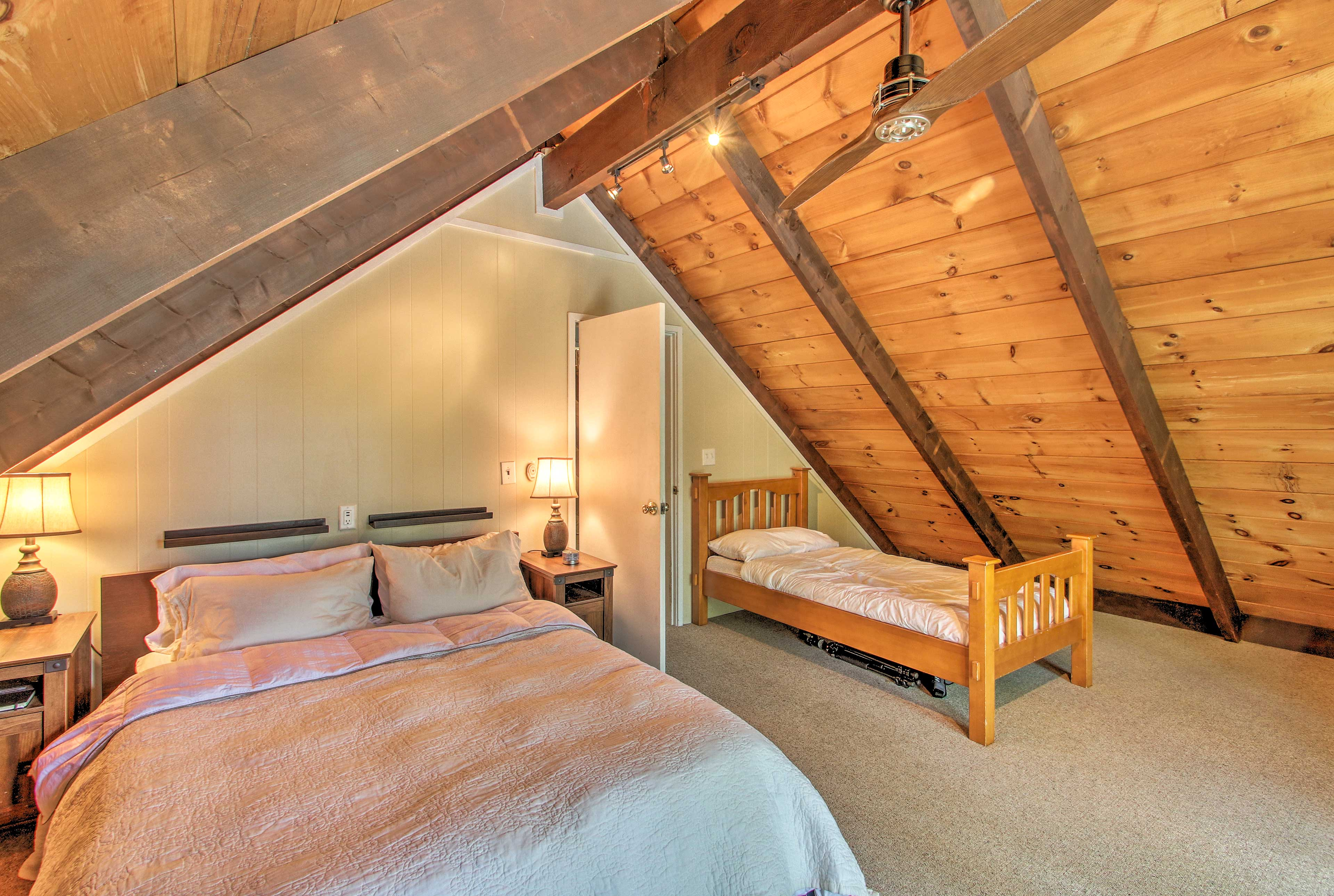 Curl up in the queen-sized bed and let the little one take the twin.