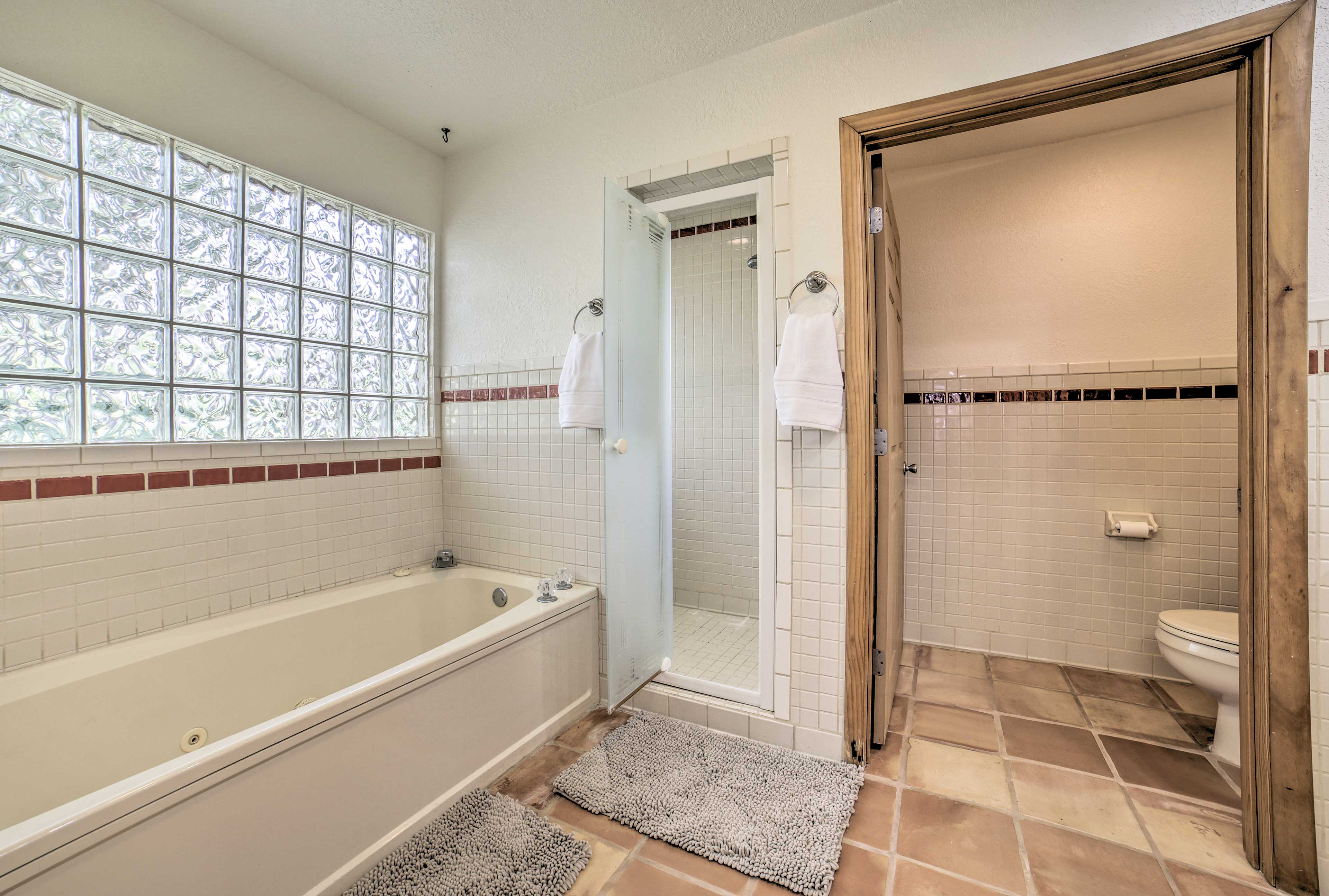 The master bathroom boasts a jetted tub and walk-in shower.