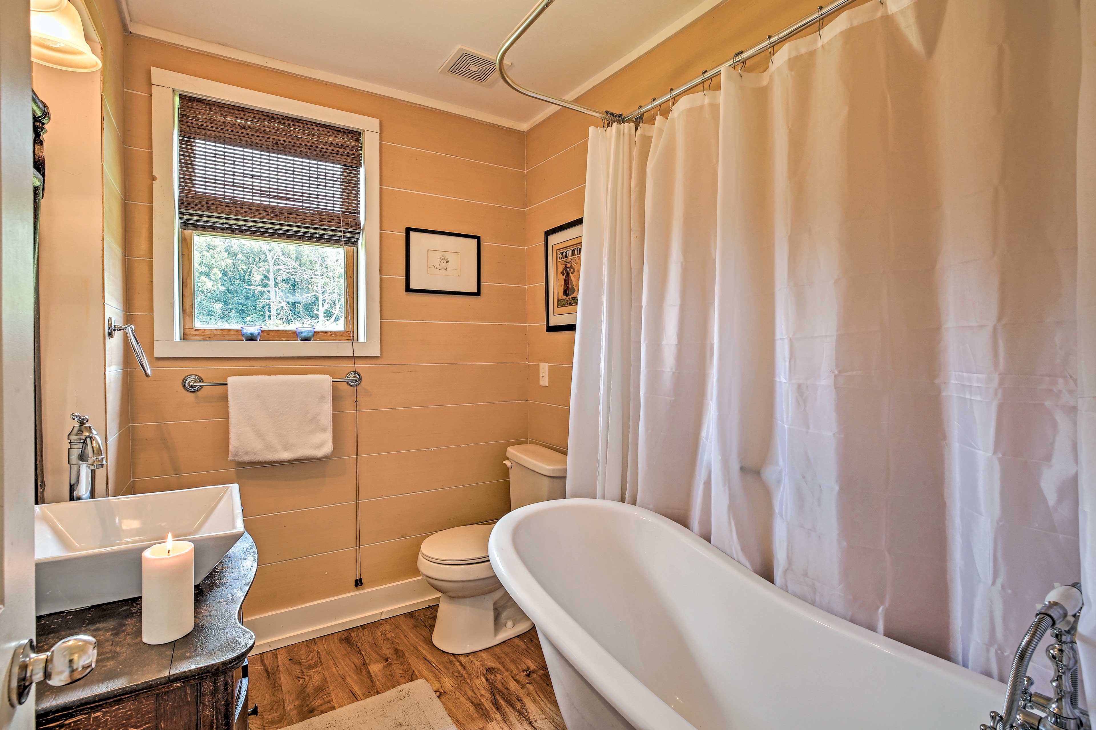 Relax in the clawfoot bathtub.