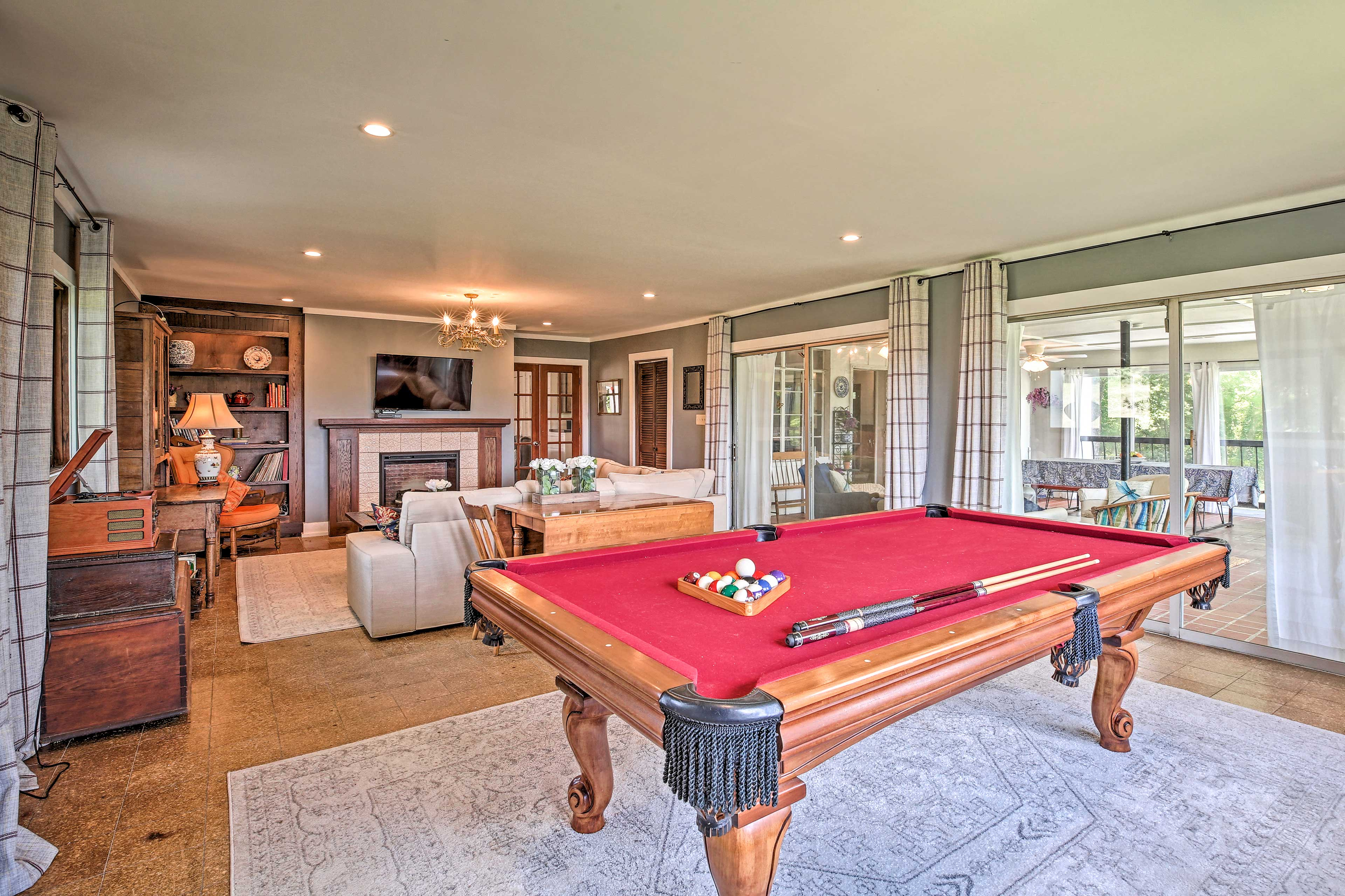 Put a record on the record player and enjoy a game of pool.