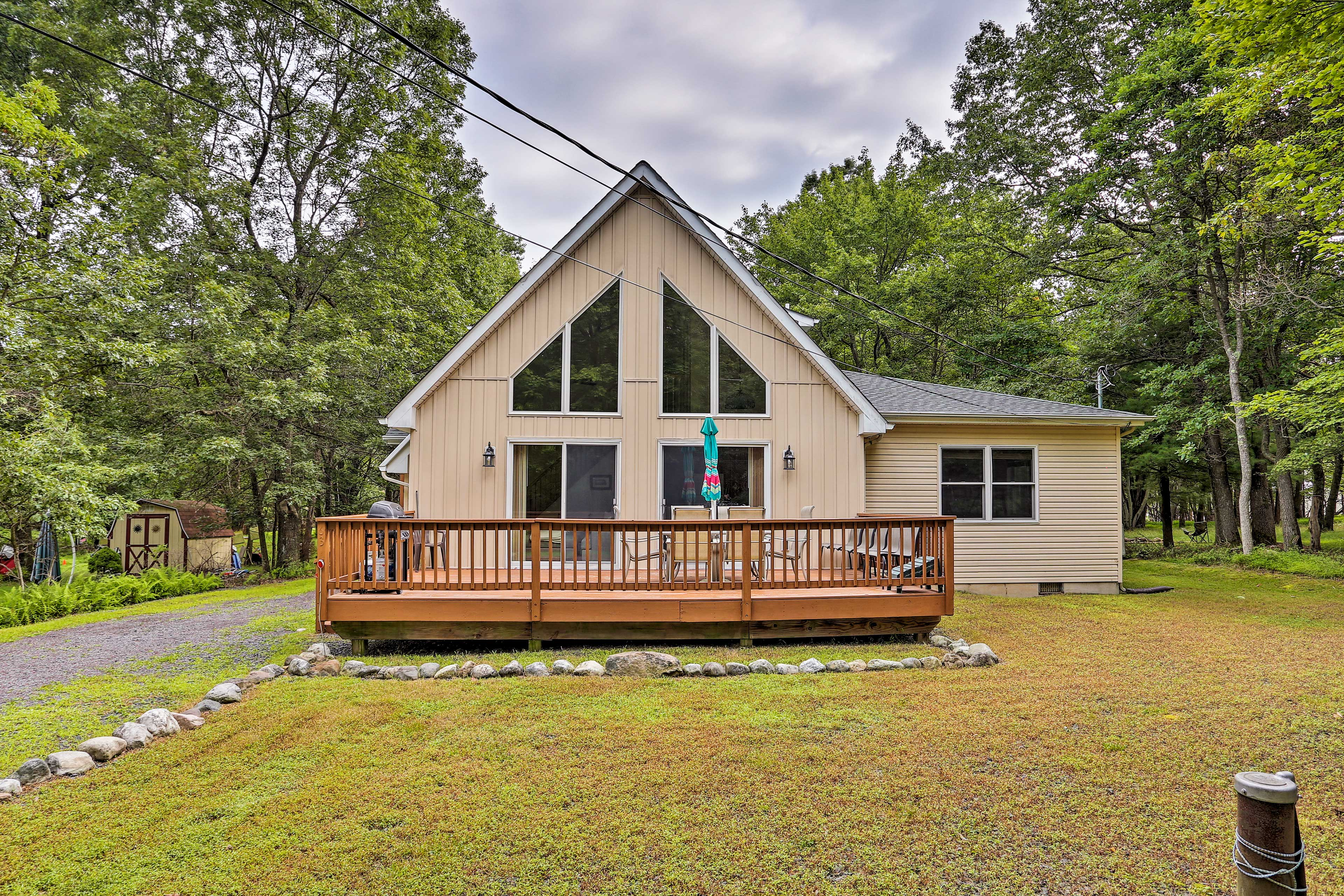 Book a trip to this cozy 4-bedroom, 2-bathroom vacation rental home for 14!