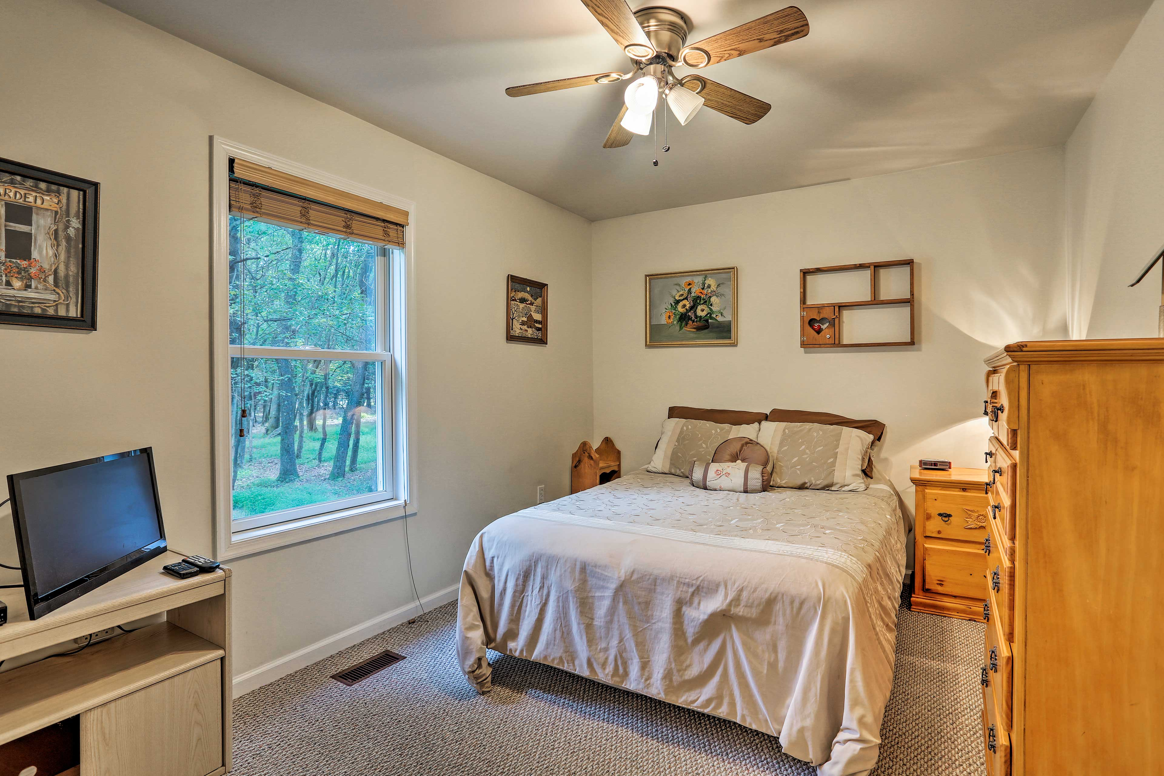 Two guests can sleep comfortably in this queen bed.