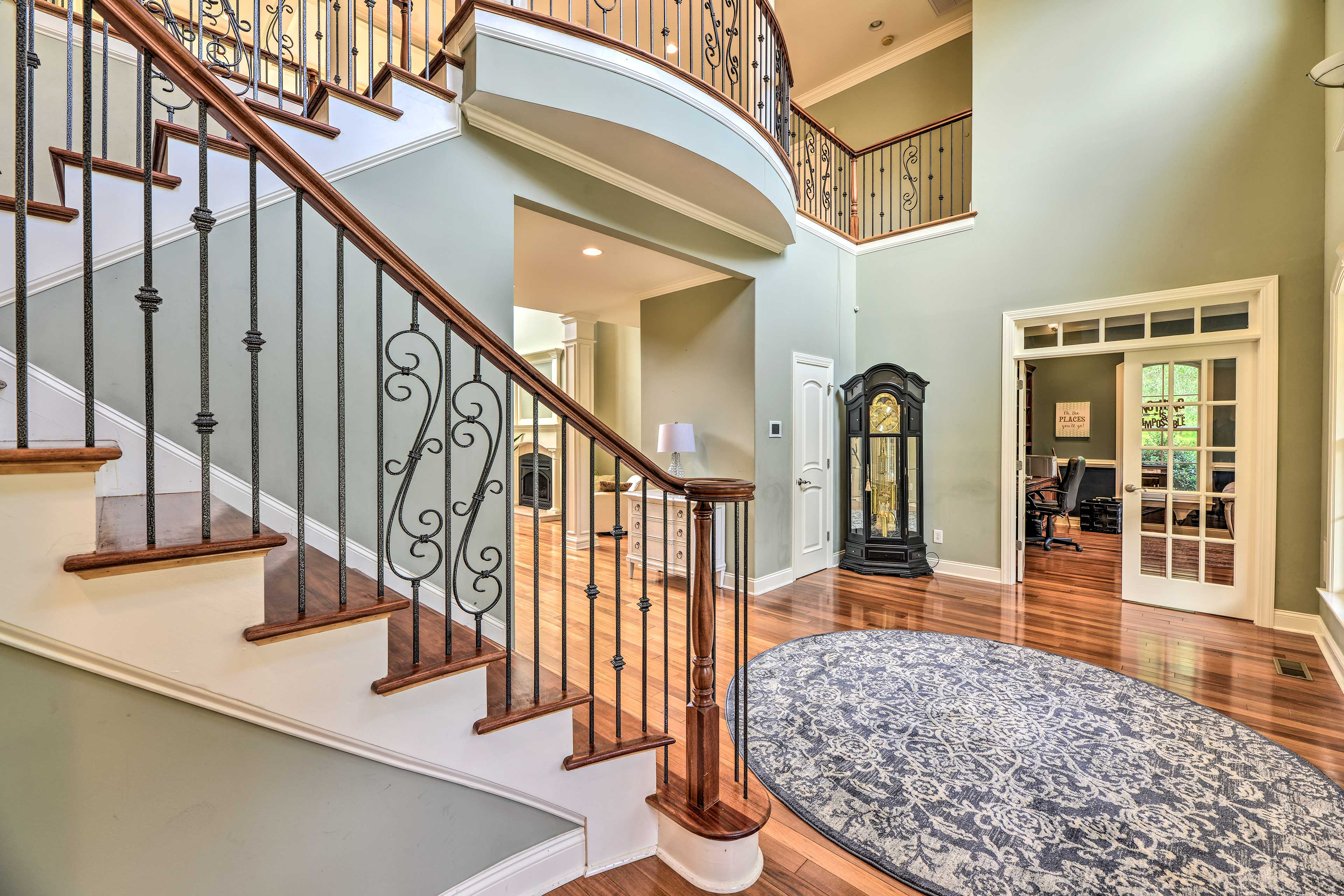 Enter the home and enjoy a grand staircase and vaulted ceilings.