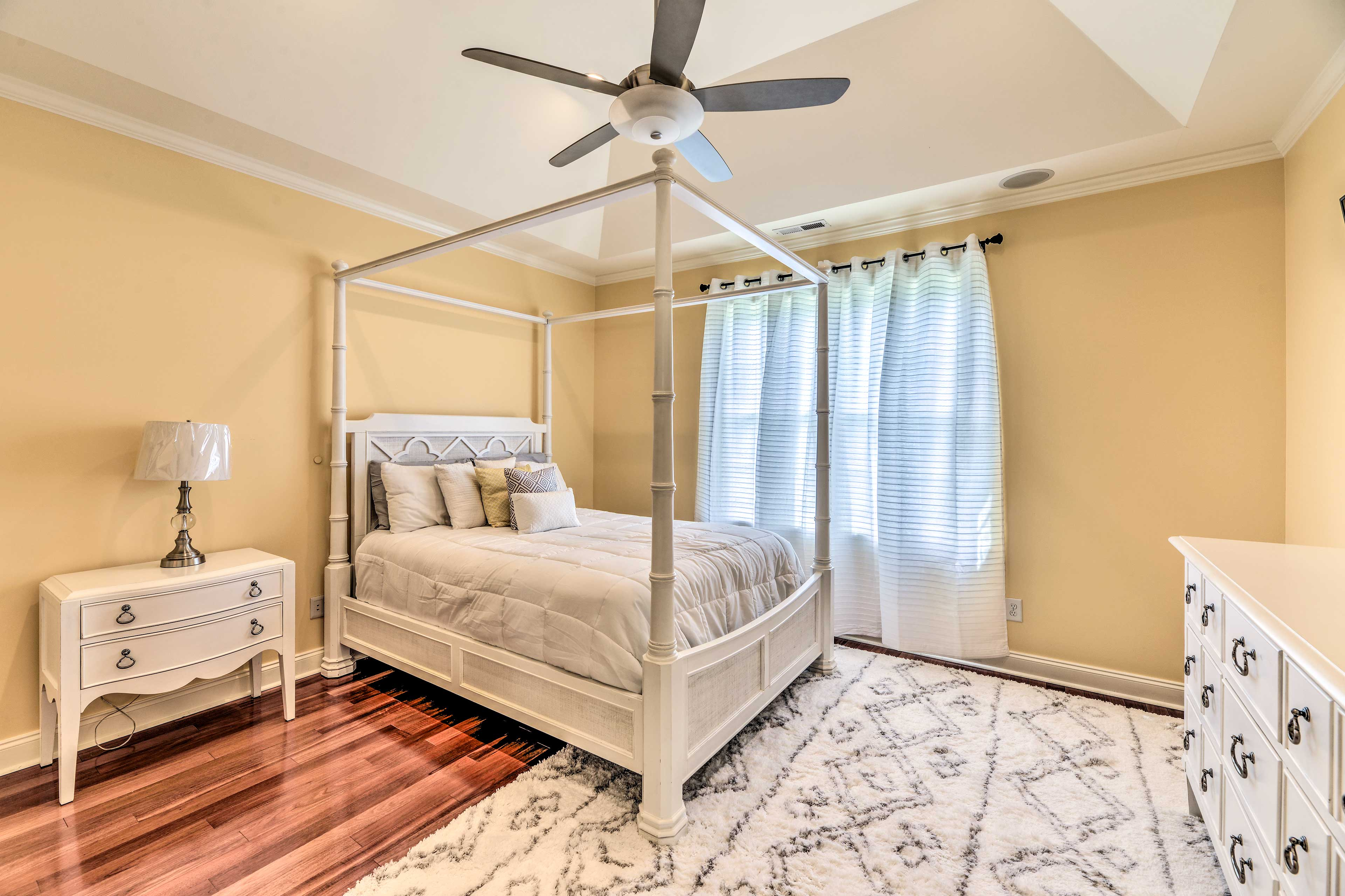 Two people will sleep soundly in this 4-posted queen bed.