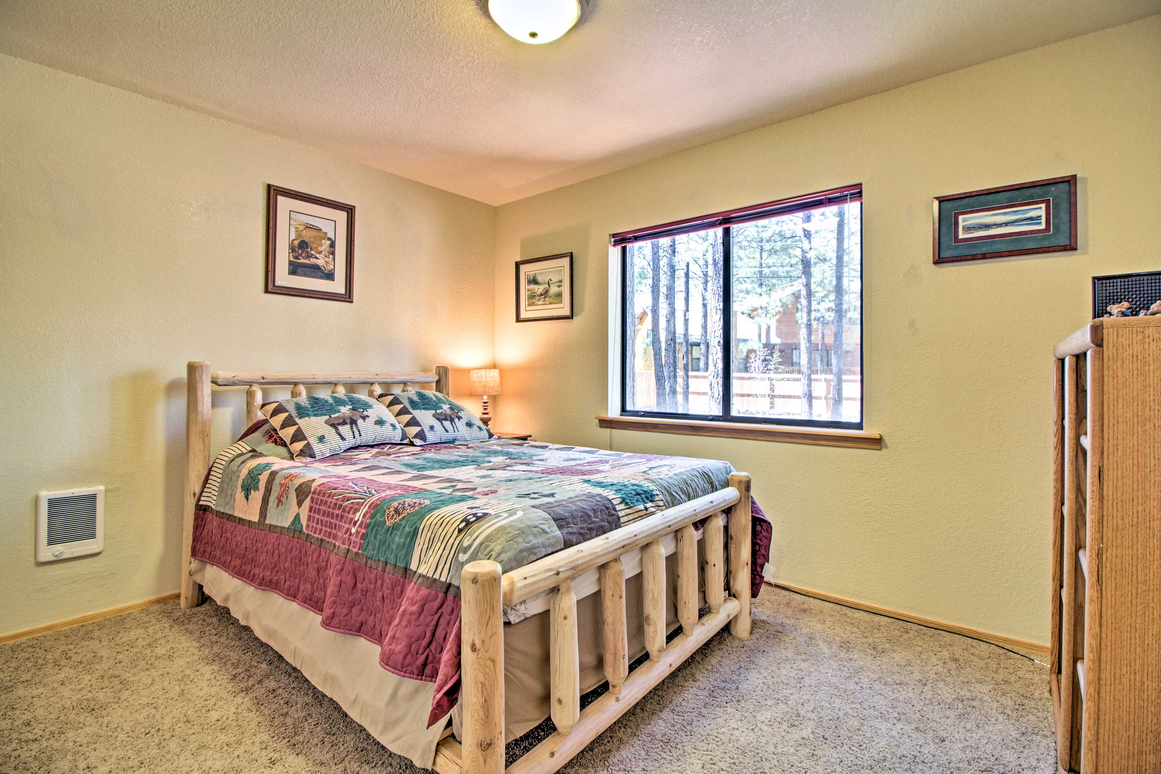 The heads of the house can sleep in the queen bed in this bedroom!