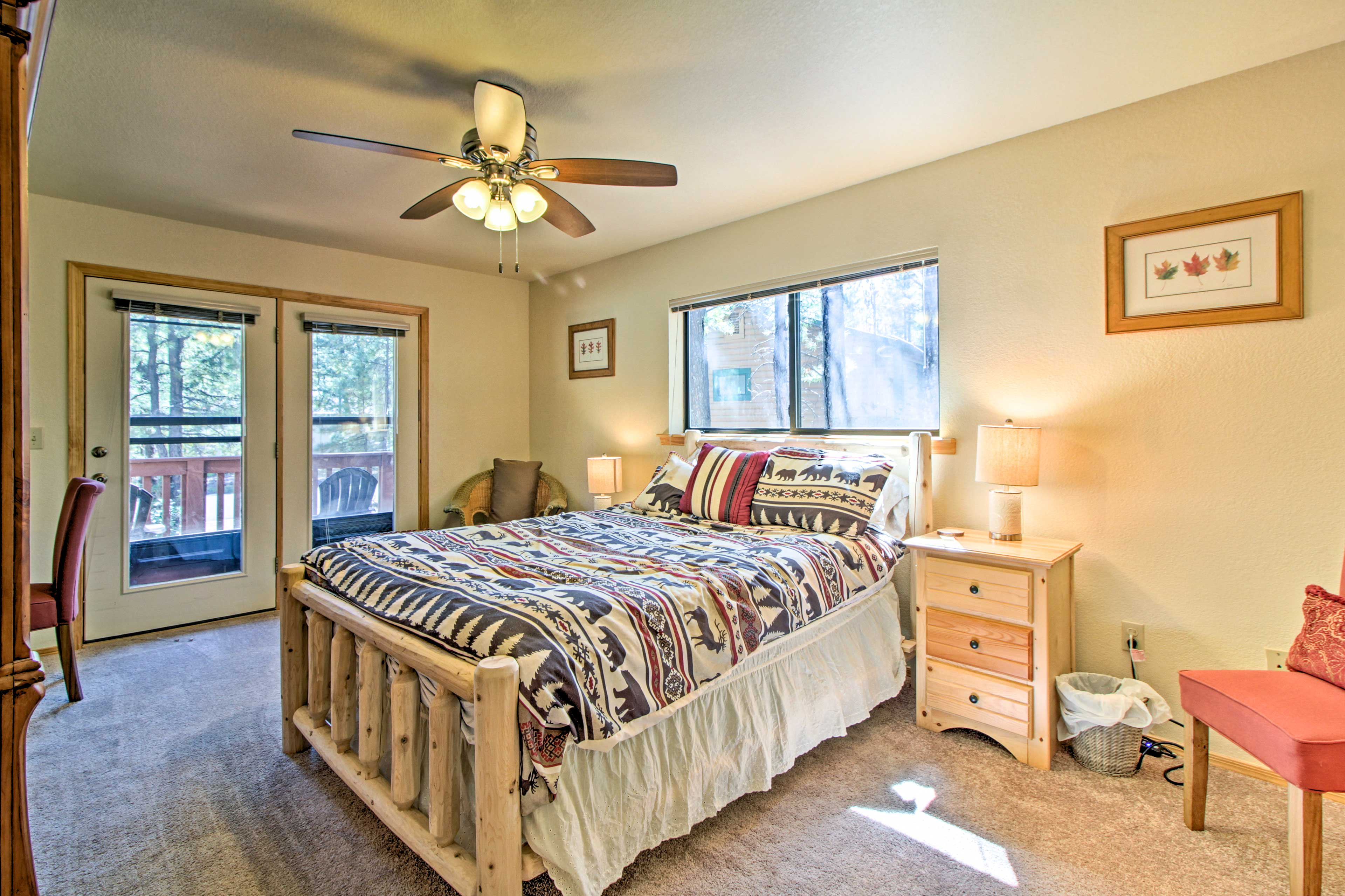 This upstairs bedroom hosts a queen bed.
