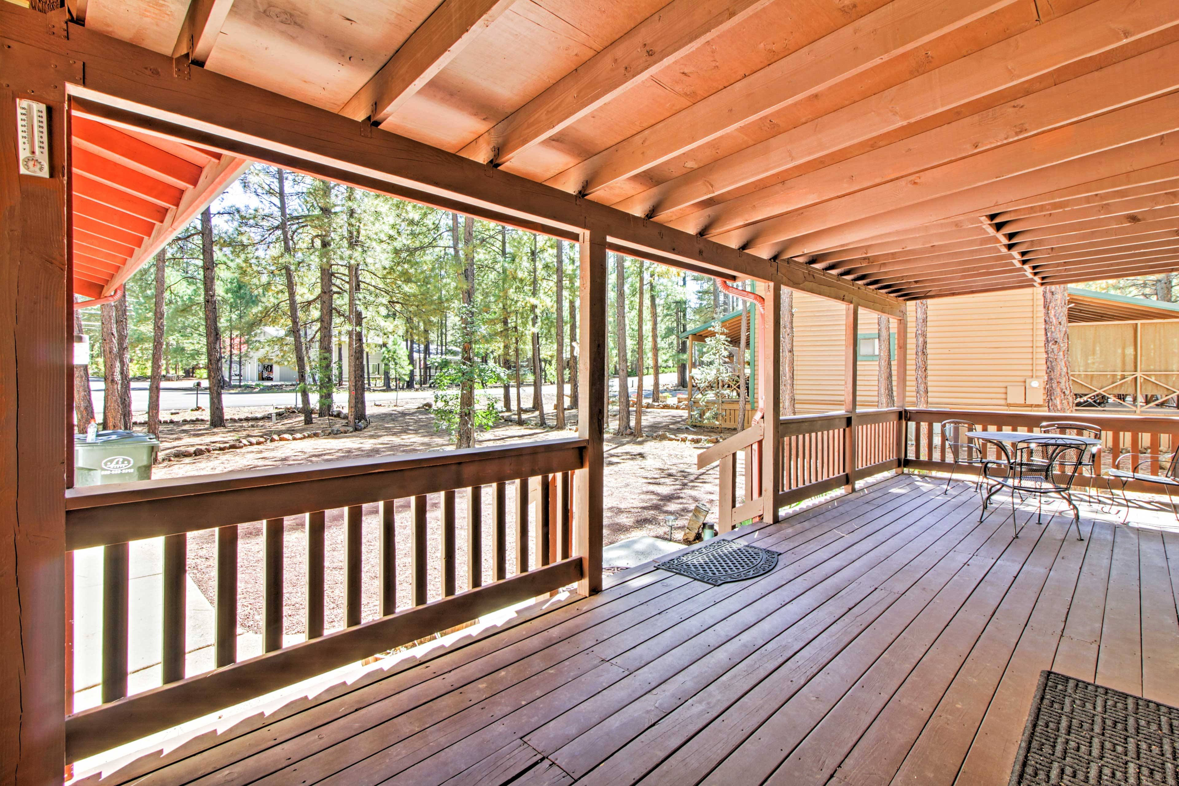 The home boasts a covered deck with a 4-person table.