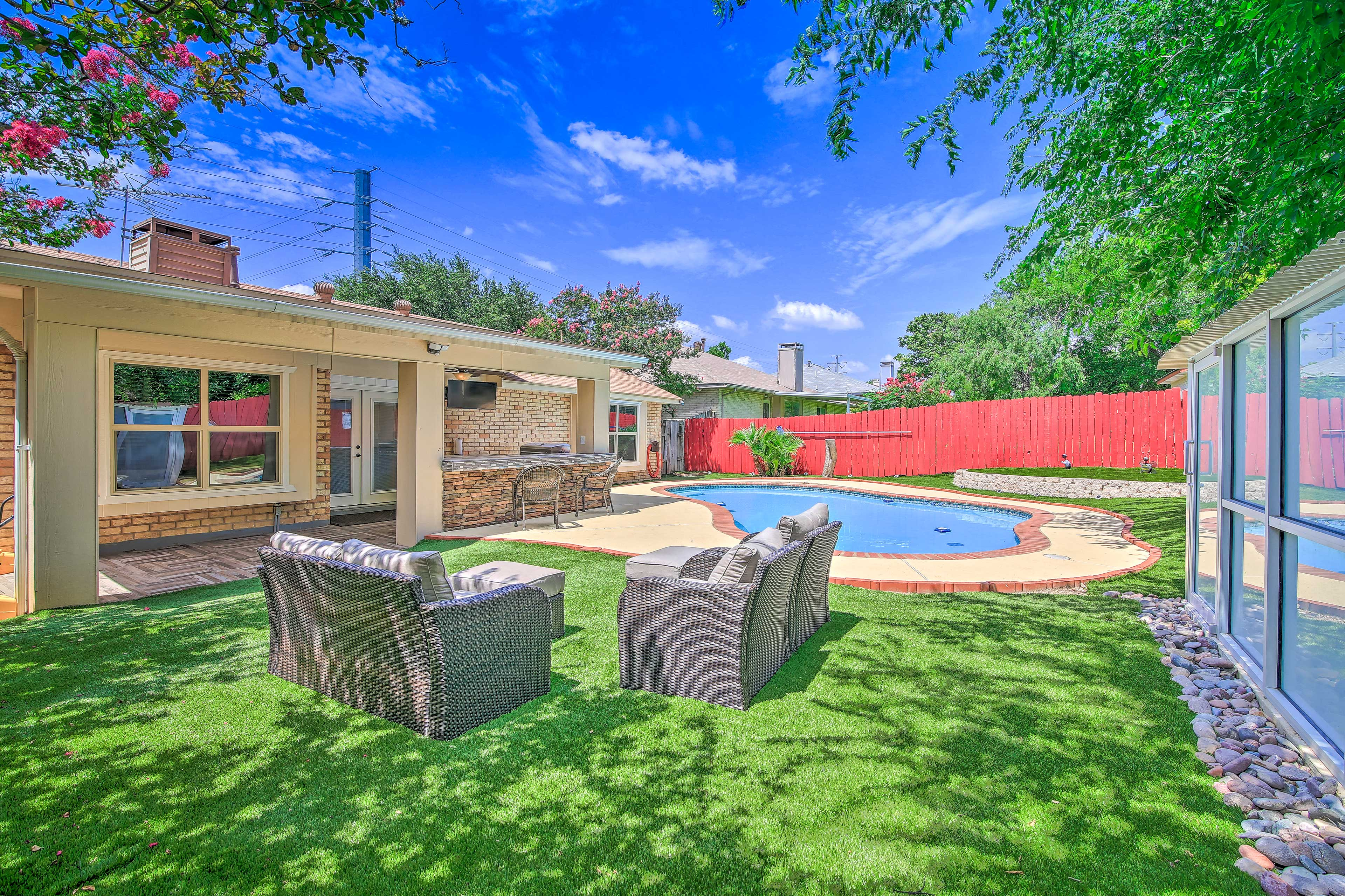 This property includes a fantastic outdoor oasis.