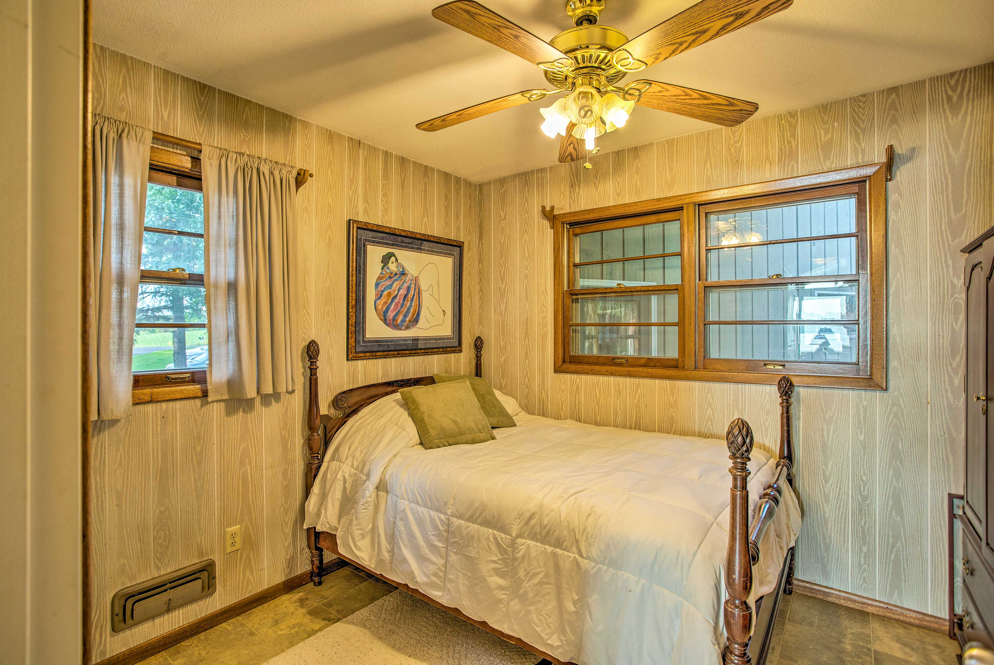This full bed is located in the bedroom located just off of the living room.