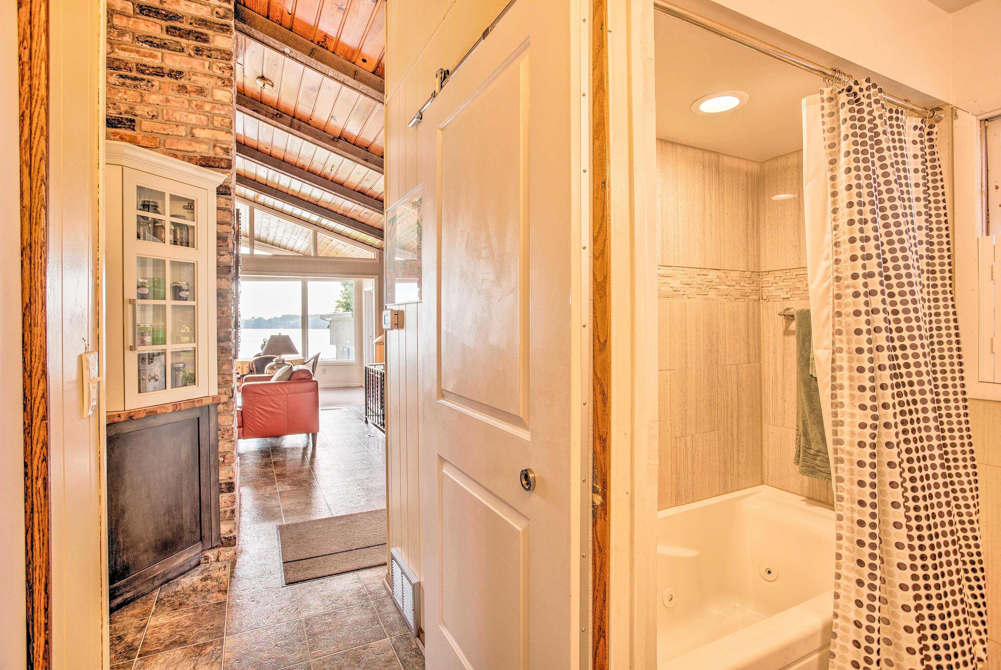 This full bathroom is located just off of the main living area.