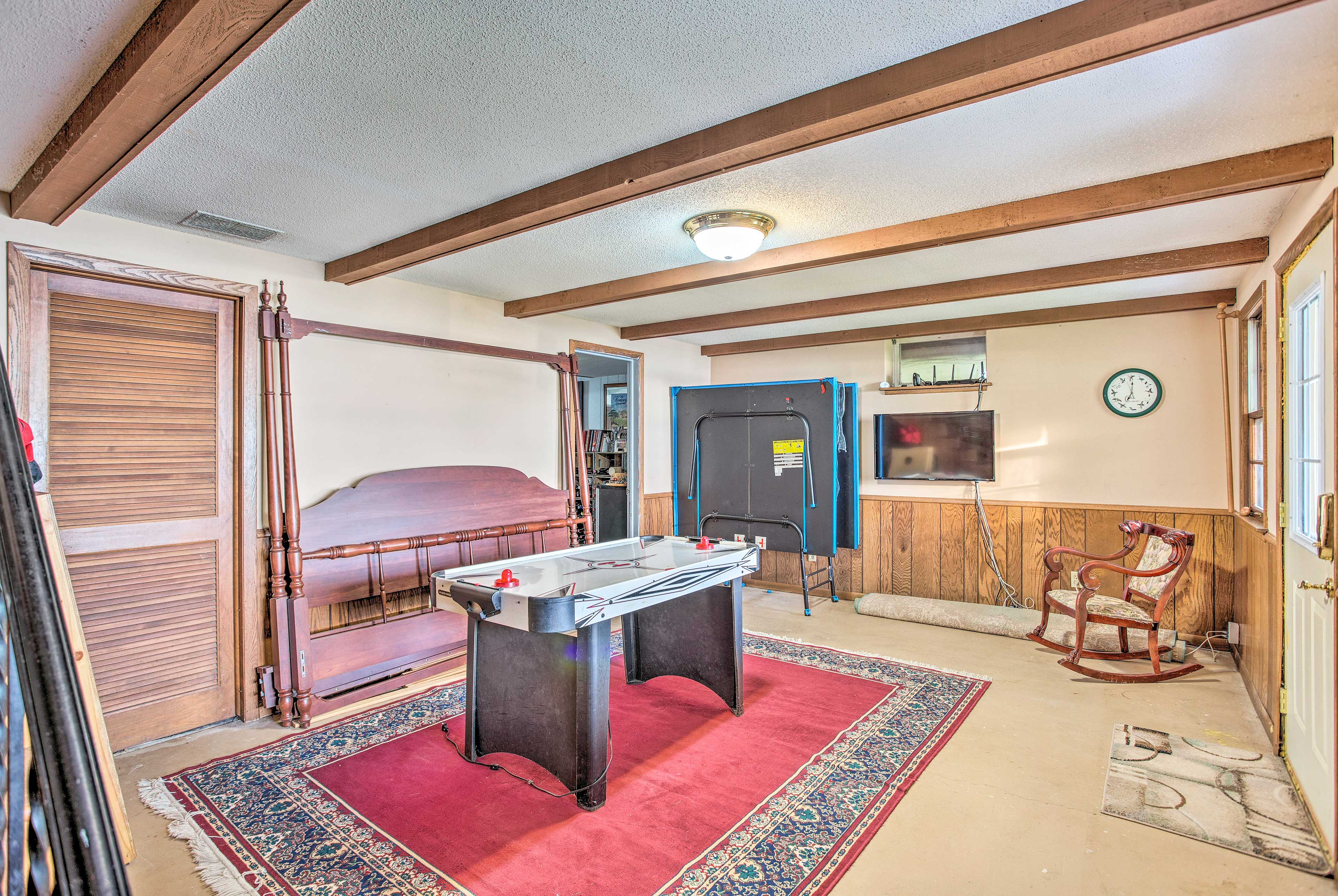 Head downstairs to reach the third bedroom and game room with air hockey.