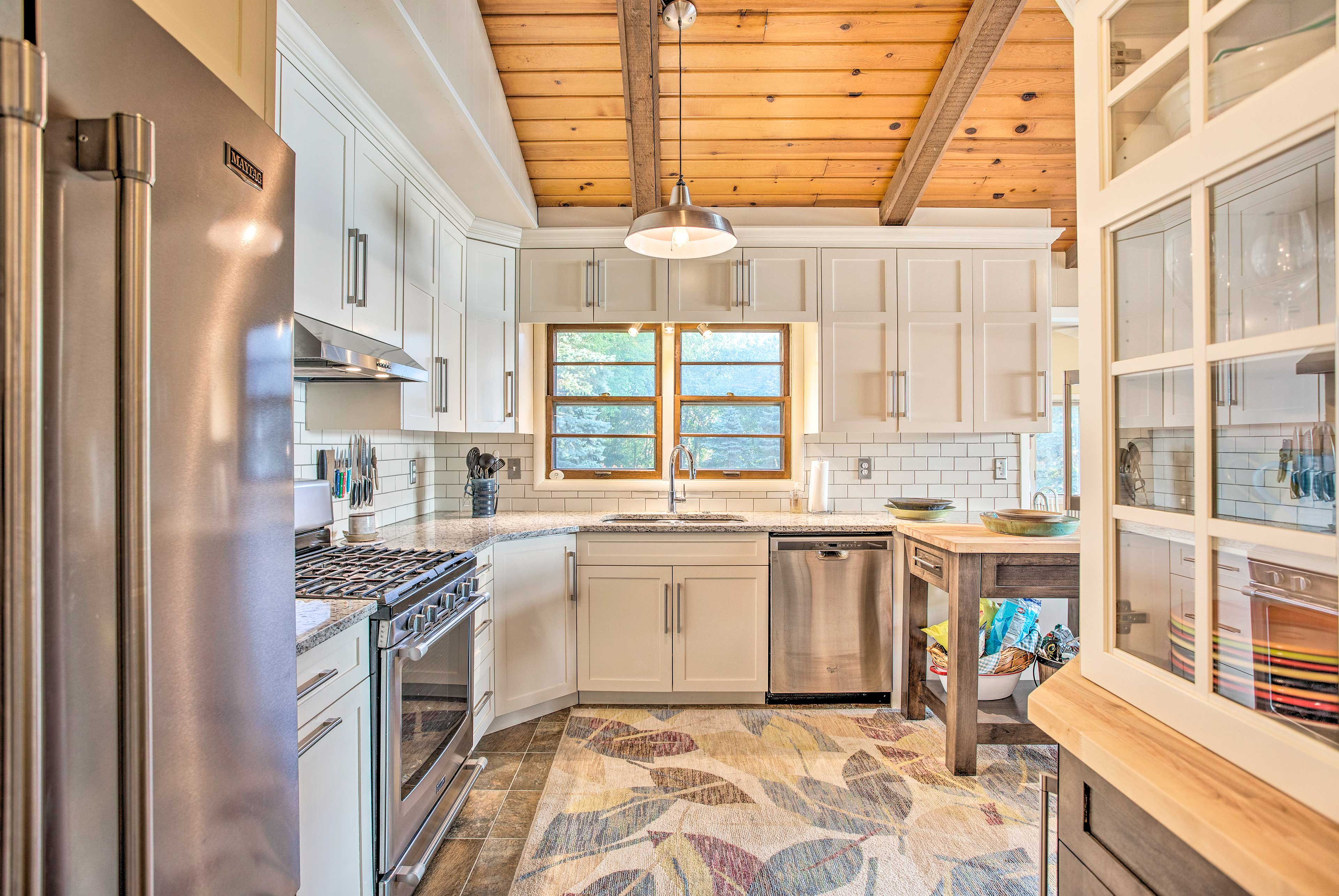 The gourmet kitchen is fully equipped with stainless steel appliances.