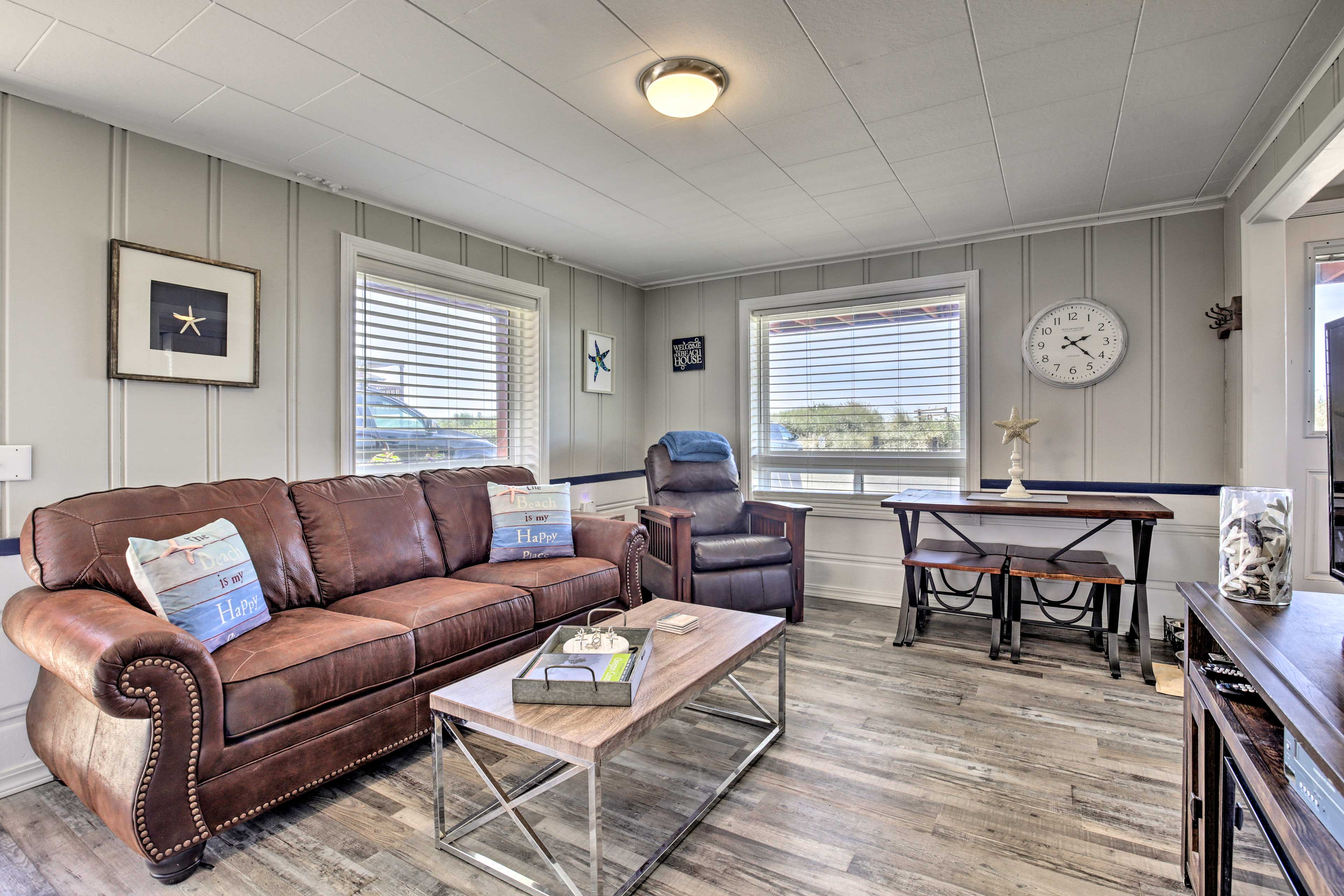 The modern interior boasts beach-inspired decor and comfortable seating.